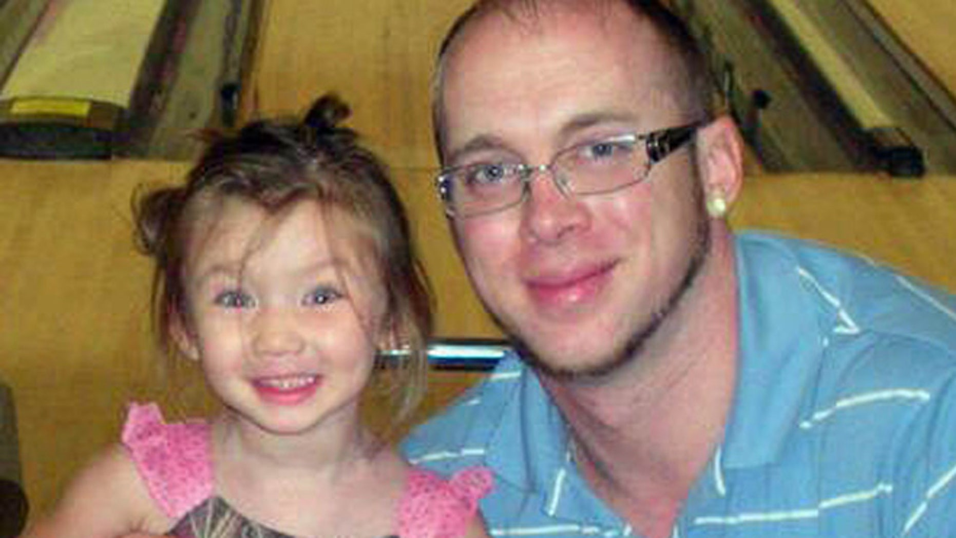 Jordan Arwood is seen with his daughter Chloe. Chloe and her cousin James Levi Caldwell were buried alive and died as a wall of dirt collapsed on them Sunday April 7, 2013.