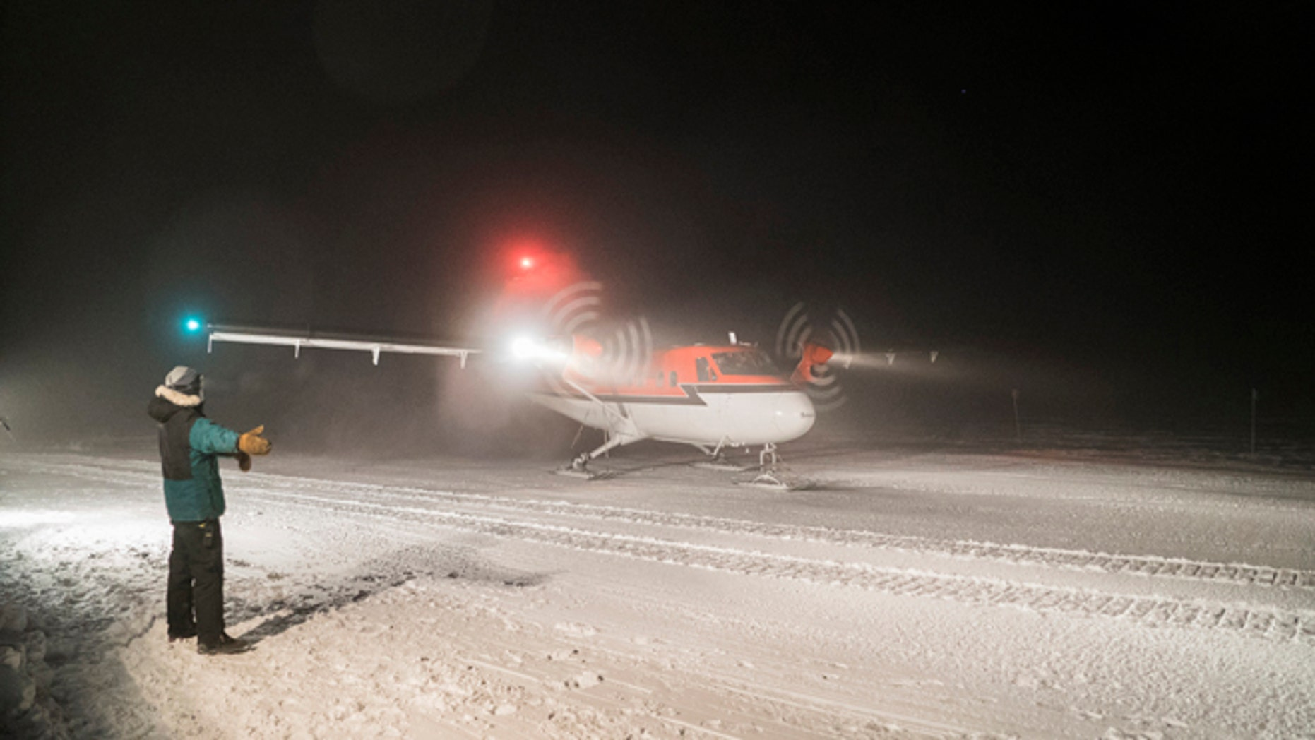 Twin Otter aircraft on a medical evacuation flight taxis on the skyway at NSF's Amundsen-Scott South Pole Station.
