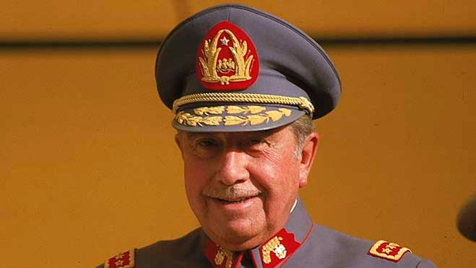 FILE - In this Oct. 1983, file photo, General Augusto Pinochet is seen in Santiago, Chile. Human rights groups and families of victims believe that military pacts of silence that hushed up many of the atrocities committed during the rule of Gen. Pinochet may finally be unraveling. (AP Photo/Eduardo Di Baia, File)