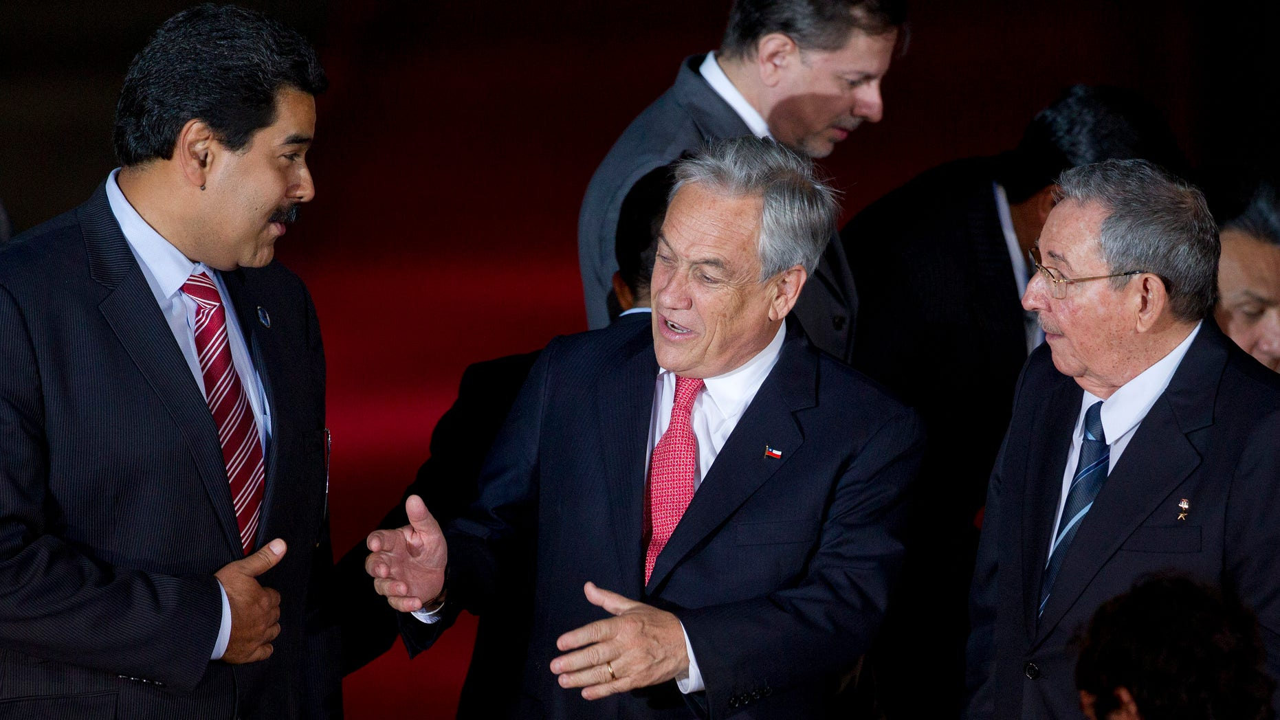 Jan. 27, 2013 - Chile's President Sebastian Pinera, center, speaks with Cuba's President Raul Castro, right, and Venezuela's Vice President Nicolas Maduro, left, at CELAC  (Community of Latin American and Caribbean Countries) summit in Santiago, Chile.