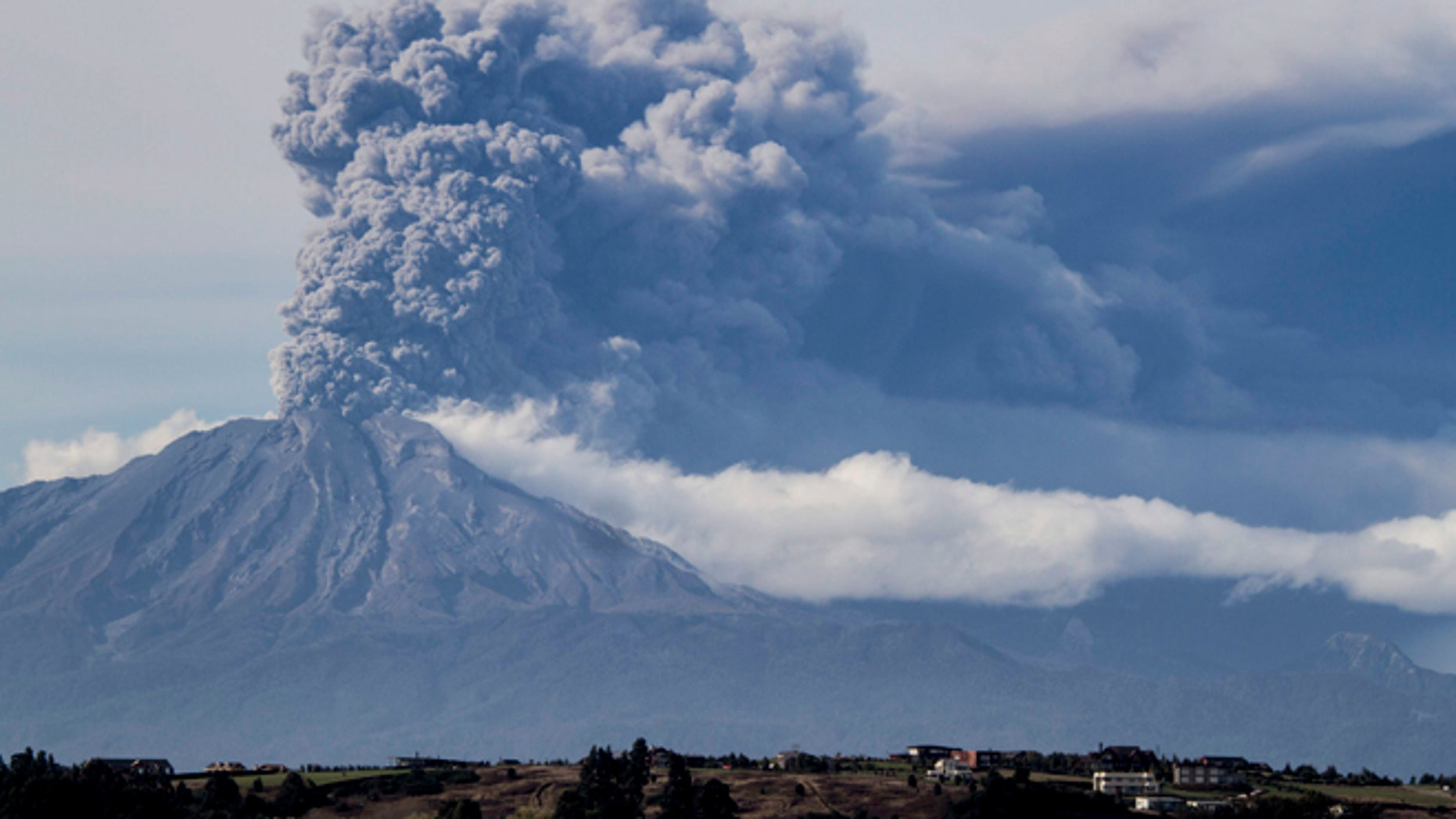 A thick plume pours from the Calbuco volcano, near Puerto Varas, Chile, Thursday, April 30, 2015.