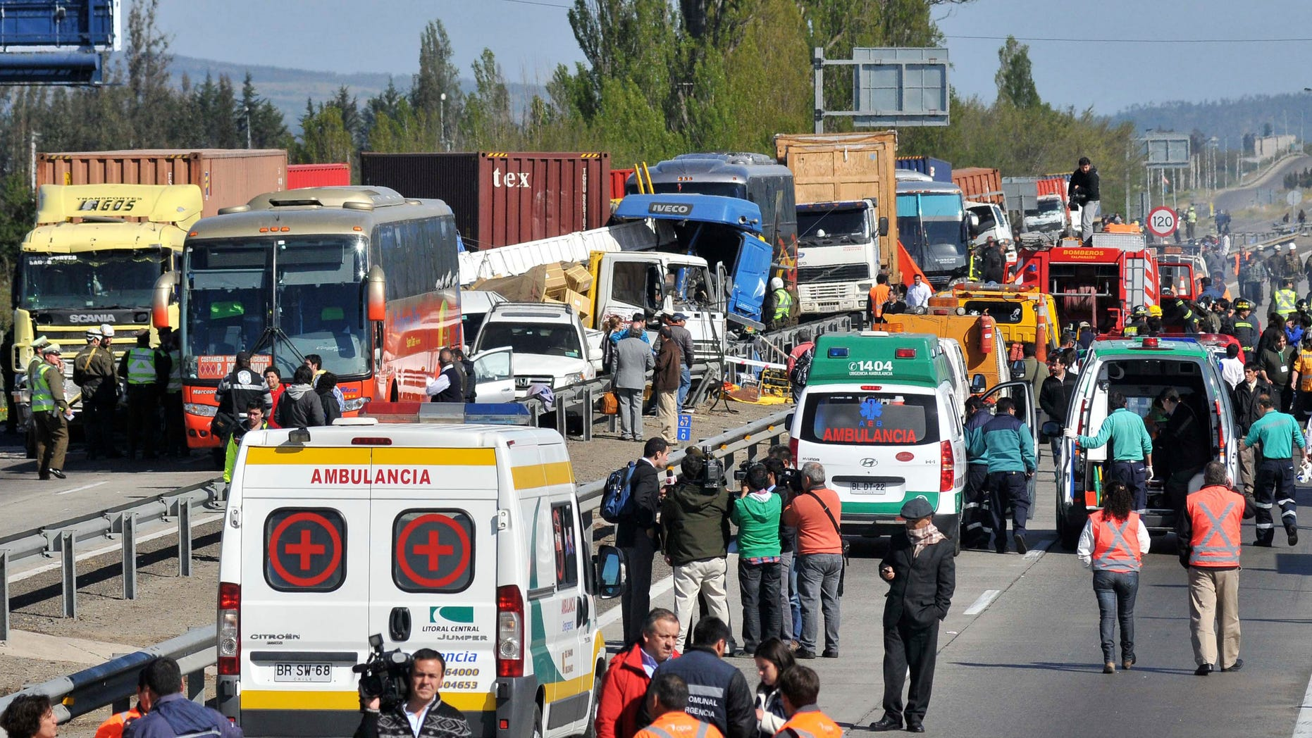 Emergency personnel gather at the scene of a multi-vehicle pile-up on a highway in Casablanca, about 43 miles or 70 kilometers from Santiago, Chile, Wednesday Oct. 12, 2011. According to government officials, at least four people died and 49 were injured.