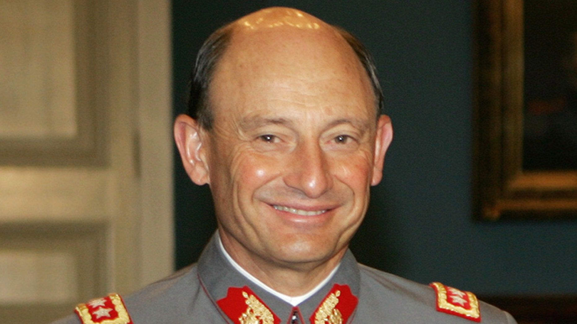 FILE - This Nov. 28, 2005 file photo, shows Chile's outgoing Army Chief Gen. Juan Emilio Cheyre at the government palace La Moneda, in Santiago, Chile. The former army chief acknowledged on Tuesday, Aug. 20, 2013, that he handed over to nuns the child of two left-wing activists killed after the 1973 military coup. Cheyre, who now heads Chile's electoral service, told the newspaper El Mercurio that he gave 2-year-old Ernesto Lejderman to a convent. In his first time speaking publicly about the case, he said that he was just following orders and that his conscience is clean. (AP Photo/Santiago Llanquin, File)