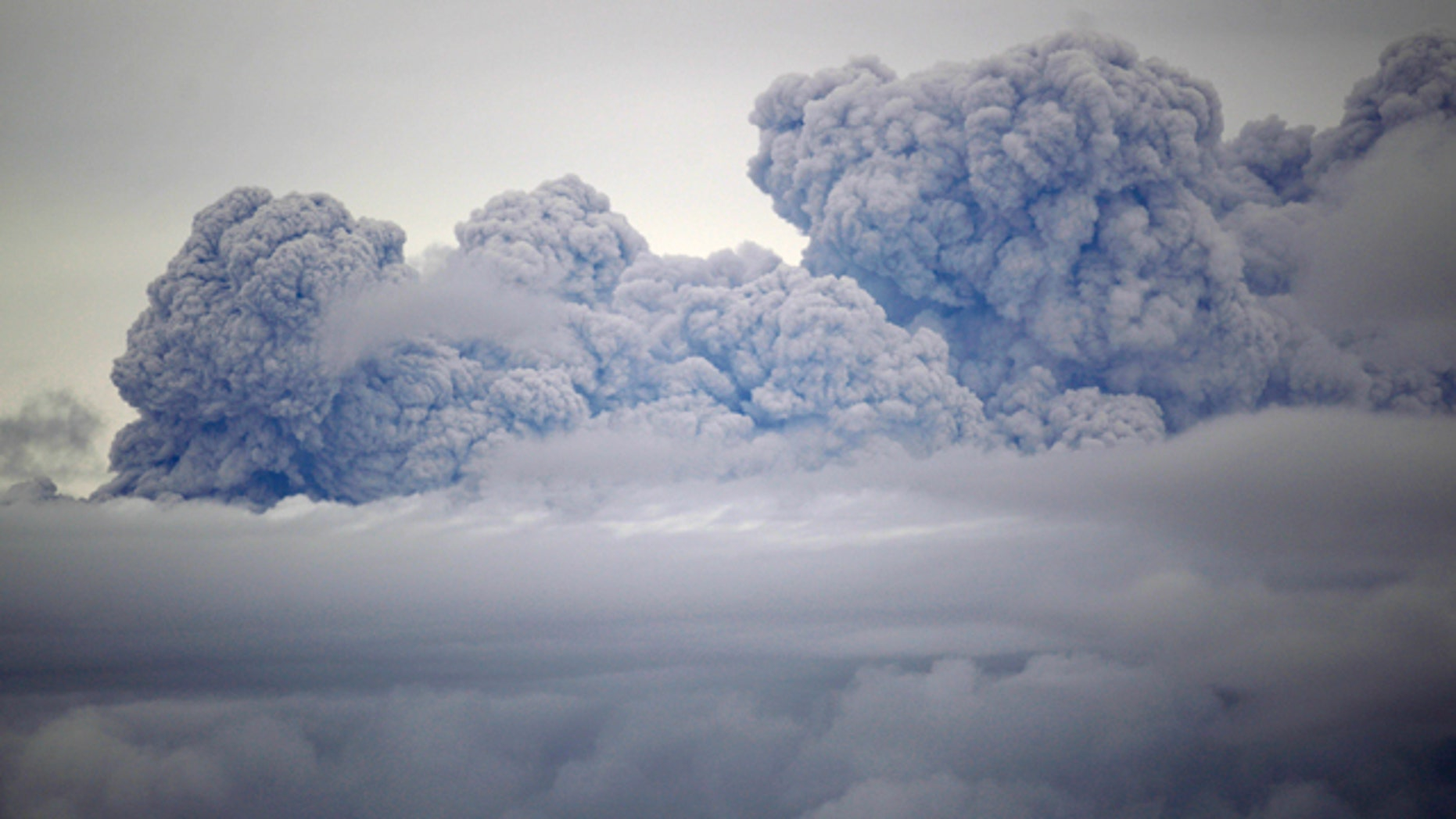 A cloud of volcanic ashes and smoke from the Puyehue-Cordon Caulle volcano is seen from Entrelagos, in southern Chile, Friday, June 10, 2011. The volcano erupted Saturday after remaining dormant for decades, causing the evacuation of about 3,500 people in the nearby area and carrying ash across the Andes to Argentina. (AP Photo/Roberto Candia)
