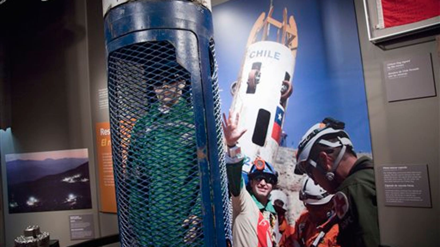 """Aug. 3, 2011: The Phoenix rescue capsule is seen on display during a press preview for the """"Against All Odds"""" exhibition commemorating the rescue of 33 Chilean miners on Wednesday at the Smithsonian National Museum of Natural History in Washington."""