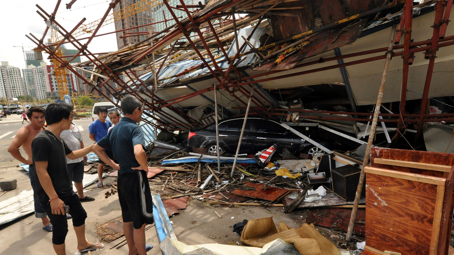 July 19, 2014 - Vehicle sits under a collapsed building after landfall of typhoon Rammasun in Haikou, capital of south China's Hainan Province. The strongest typhoon to hit southern China in four decades has killed at least 26 people in China, and 11 more in Vietnam.