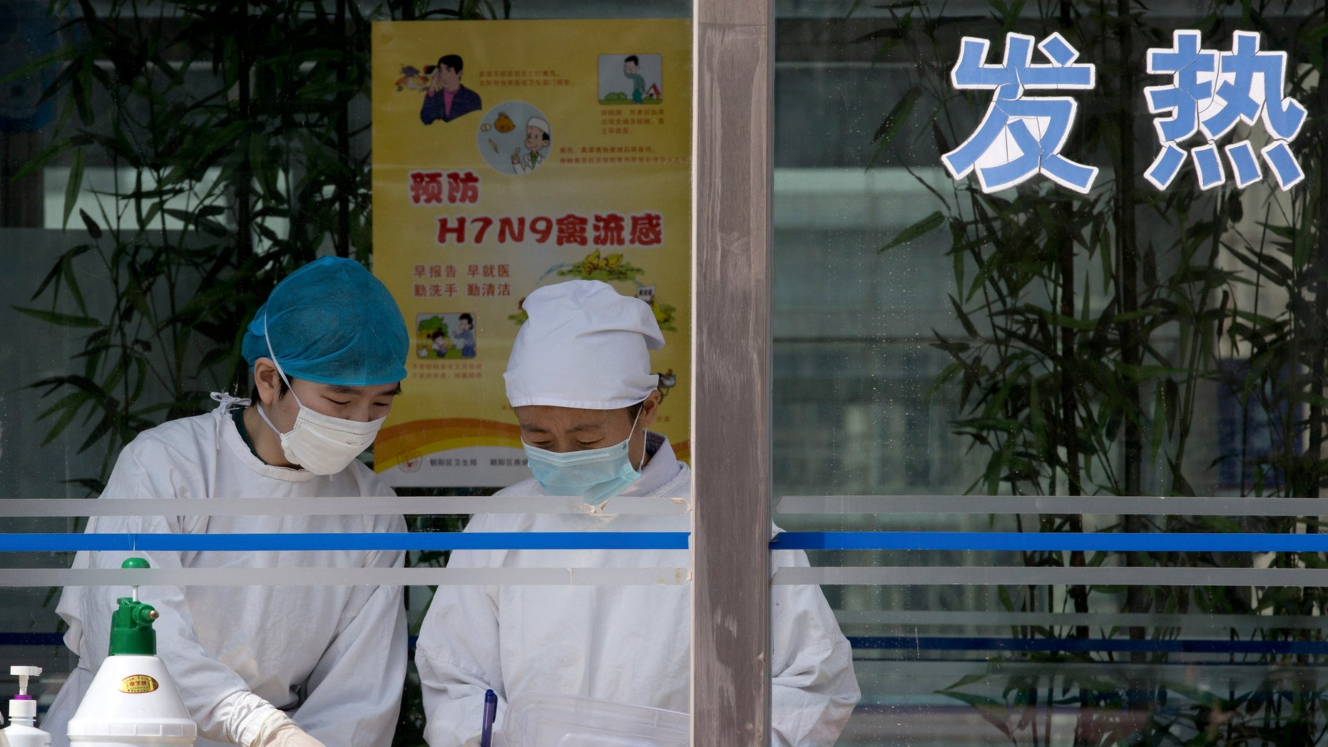 April 14, 2013: Nurses collect patients' blood samples at a specialized fever clinic inside the Ditan Hospital, where a Chinese girl is being treated for the H7N9 strain of bird flu, in Beijing.