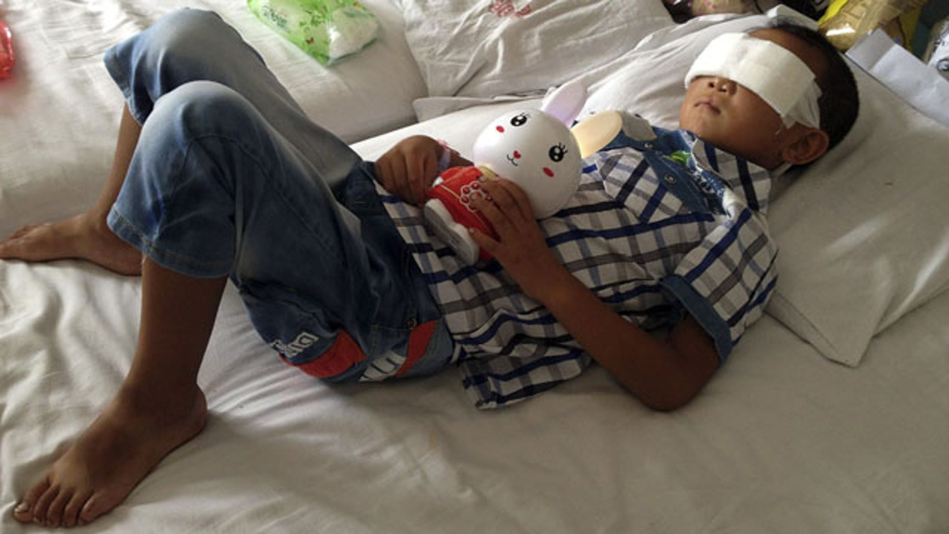 August 28, 2013: Guo Bin lies on a bed in a hospital as he recuperates from an attack in the rural area of Linfen city that left him blind, in Taiyuan in northwest China's Shanxi province. (AP Photo)