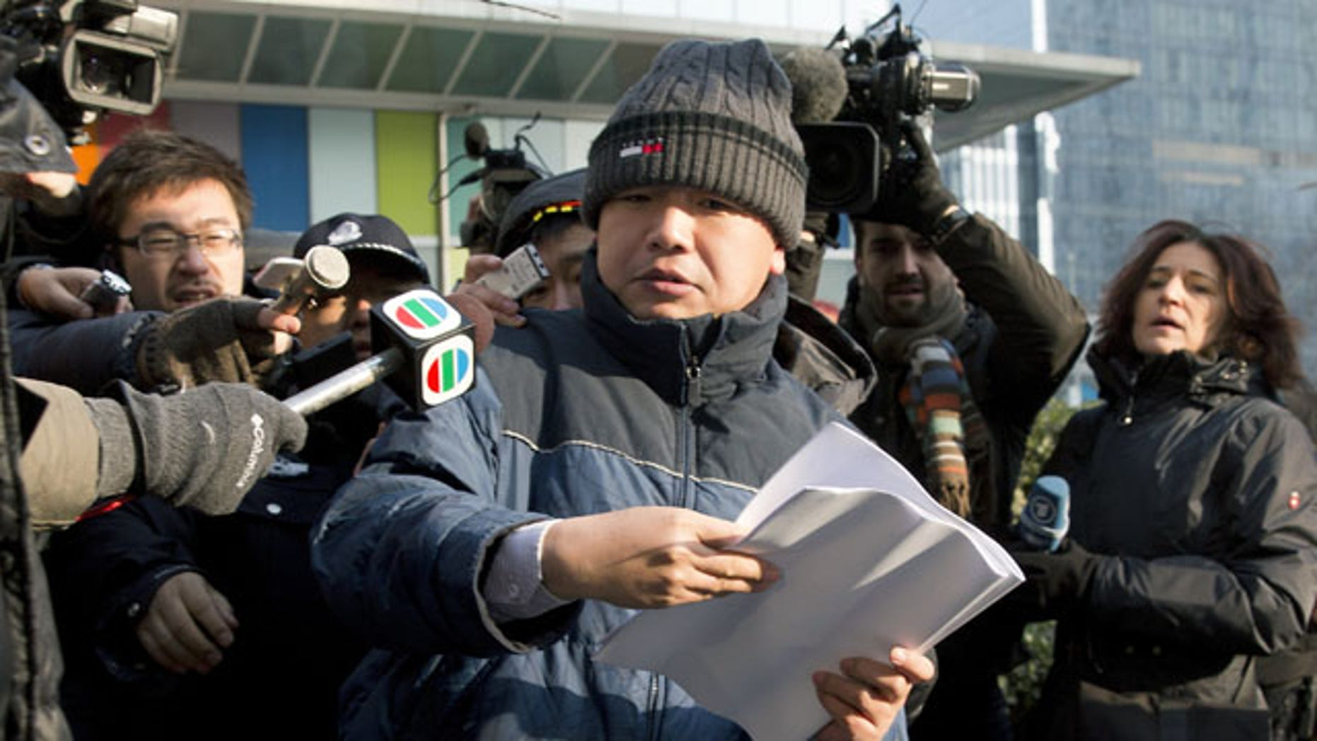 January 26, 2014: Zhang Qingfang, lawyer of legal scholar and founder of the New Citizens movement Xu Zhiyong, speaks to the media near the No. 1 Intermediate People's Court, in Beijing . The Beijing court on Sunday sentenced Xu to four years in jail for disrupting order in public places, in a case that the U.S. government and other critics say is retribution against his push to fight corruption and create equal educational opportunities. (AP Photo/Andy Wong)