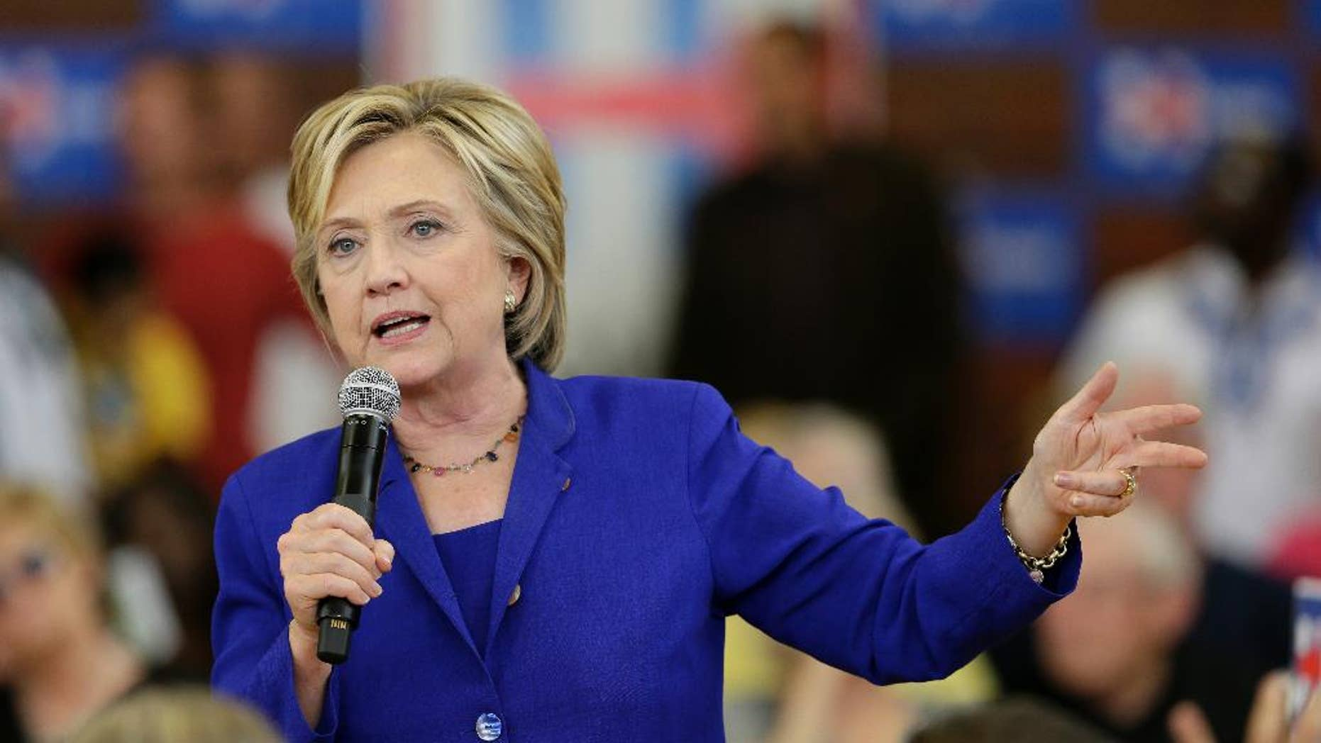 """In this Sept. 22, 2015 file photo, Democratic presidential candidate Hillary Rodham Clinton speaks during a community forum on healthcare, at Moulton Elementary School in Des Moines, Iowa. A Chinese government official said Monday, Sept. 28, 2015,  that Hillary Clinton was """"biased"""" on women's issues in China, while a newspaper compared the presidential hopeful to Donald Trump for her tweet saying it was """"shameless"""" for China's president to preside over a U.N. conference on gender equality. (AP Photo/Charlie Neibergall, File)"""