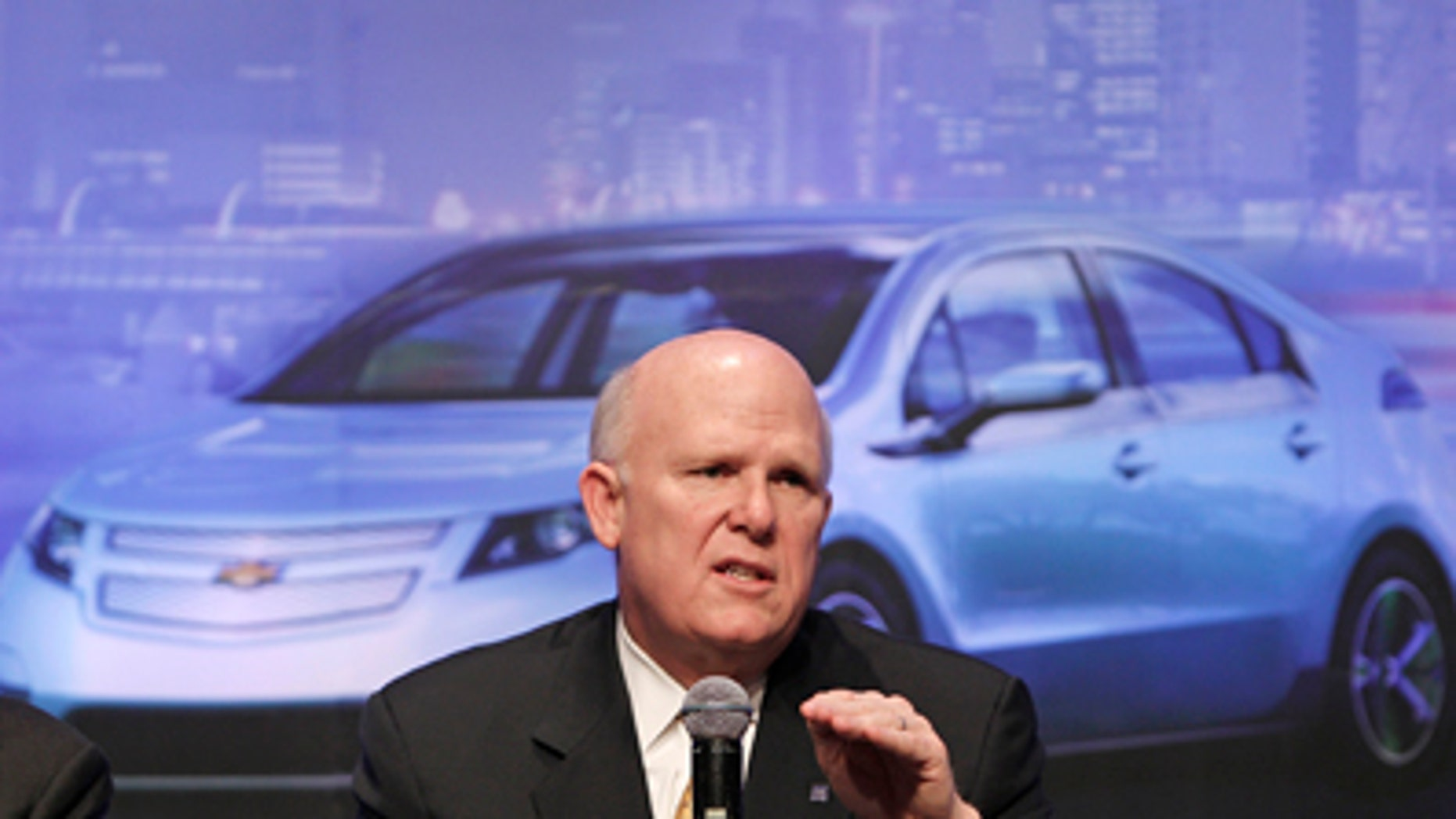 General Motor Co. Chief Executive Daniel Akerson gestures as he speaks during a media conference in Beijing Tuesday, Feb. 15, 2011. China will play a much bigger role in GM's plans as it moves to capitalize further on the world's largest auto market, Akerson said Tuesday. (AP Photo/Andy Wong)