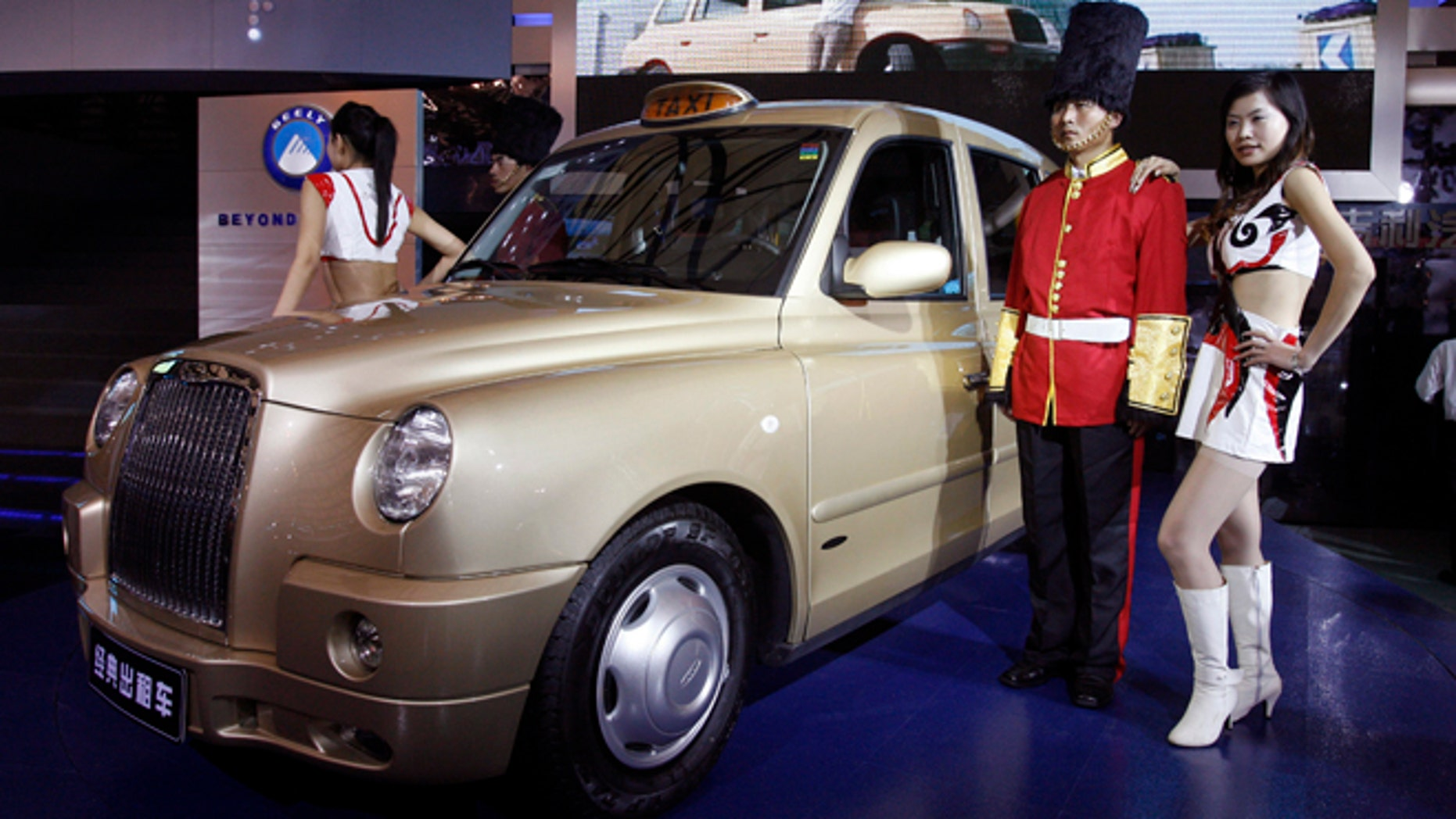 In this photo taken Saturday, April 21, 2007, the TX4 London cab built under a joint venture company between Manganese Bronze Holdings Plc and Geely Automobile Holdings Limited and Shanghai Maple is unveiled during the Shanghai Auto 2007 held in Shanghai, China. The Chinese automaker that bought Sweden's Volvo Cars in 2010 has acquired the British manufacturer of the distinctive London cab. Geely Holding Group said Friday, Feb 1, 2013 it bought Manganese Bronze Holdings out of bankruptcy court administration. Geely said it paid just over 11 million pounds ($17.5 million).(AP Photo/Ng Han Guan)