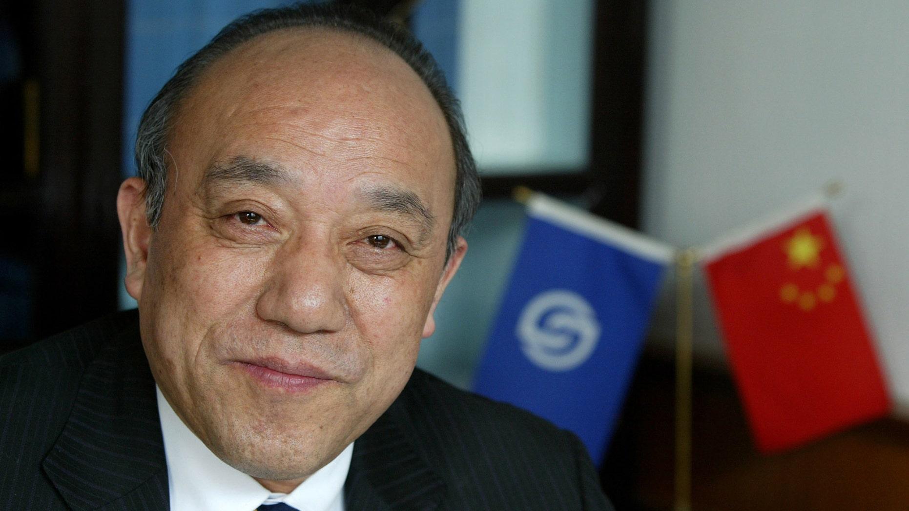 Feb. 21, 2004: Lu Guanqiu, board chairman of Wanxiang Group, sits in his office at the company's headquarters in Xiaoshan, China.