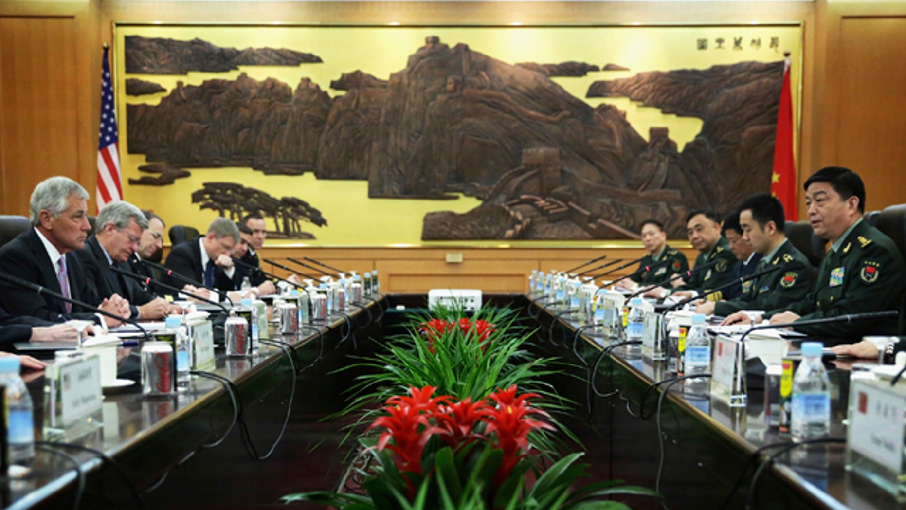 April 8, 2014: U.S. Secretary of Defense Chuck Hagel, left, and Chinese Minister of Defense Chang Wanquan, right, take seat prior to their meeting at the Chinese Defense Ministry headquarters in Beijing. Hagel arrived in Beijing after a stop in Japan, where he told reporters that China must be more open about its military buildup and better respect its neighbors - a pointed allusion to Beijing's ongoing territorial dispute with Japan and others over remote islands in the East China Sea. (AP Photo/Alex Wong, Pool)
