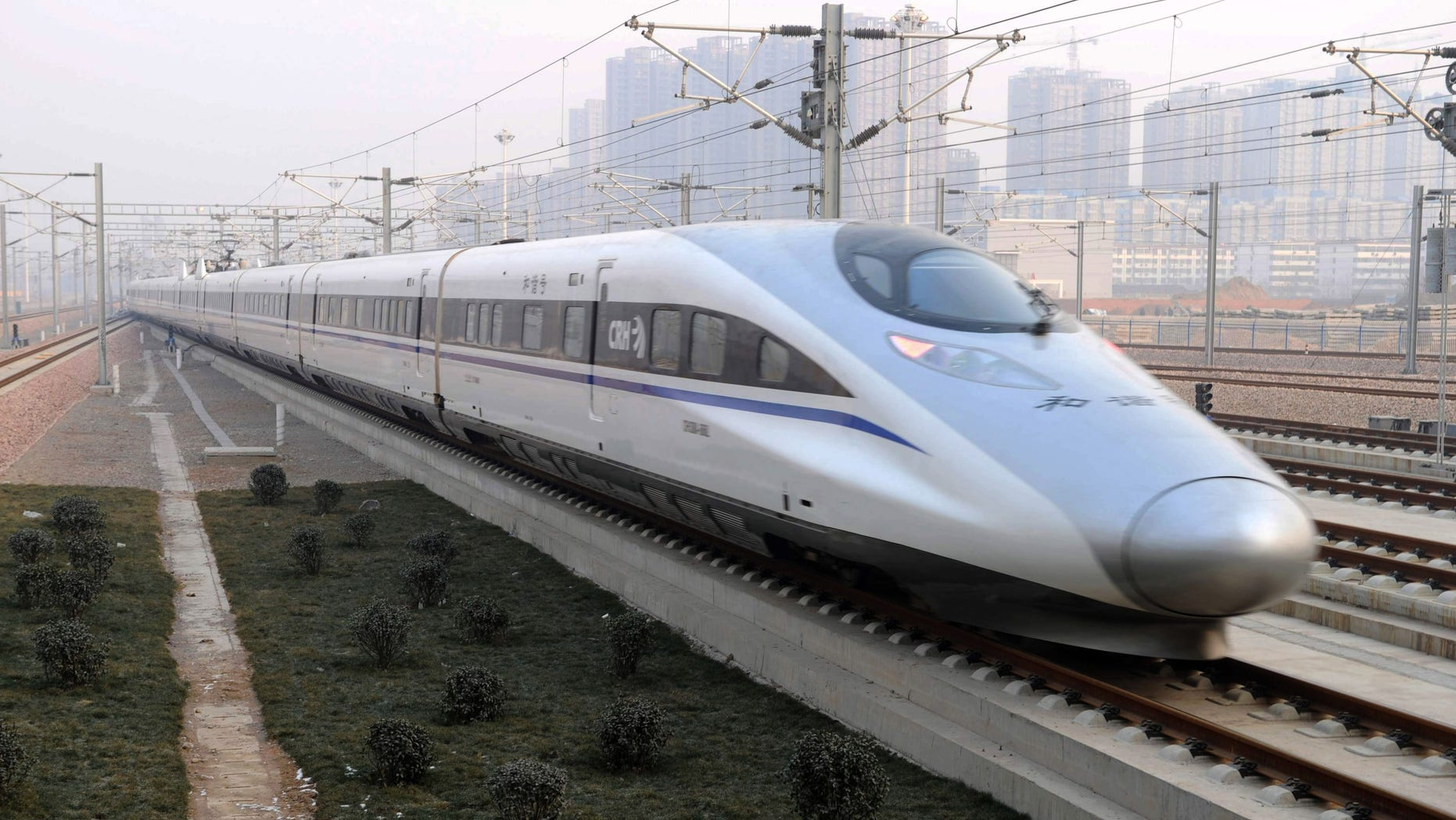 Dec. 26, 2012: In this photo released by China's Xinhua news agency, a high-speed train G802 leaves for Beijing from Shijiazhuang, capital of north China's Hebei Province.
