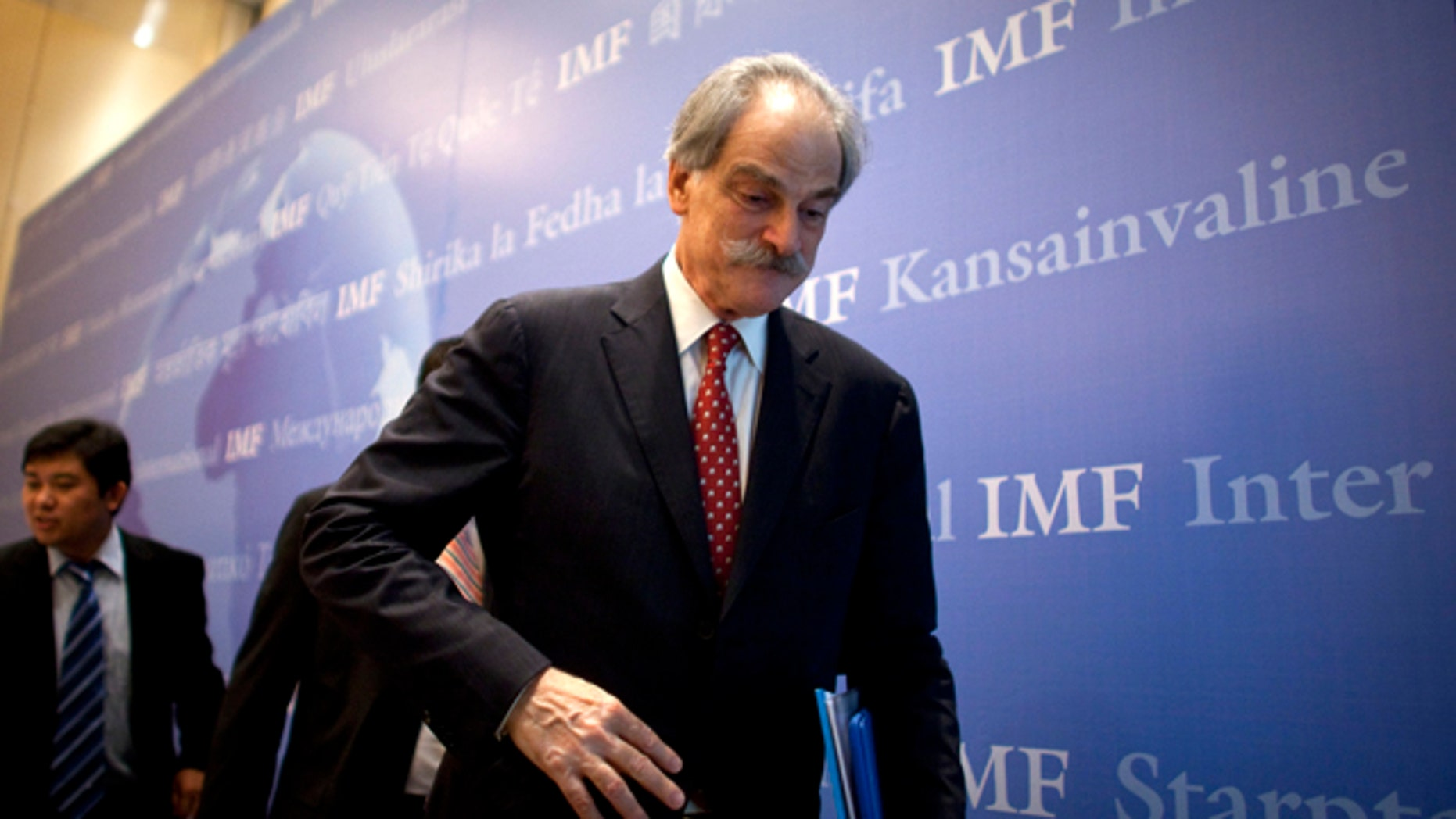 June 9, 2011: John Lipsky, acting managing director of the International Monetary Fund,  leaves a press conference in Beijing.