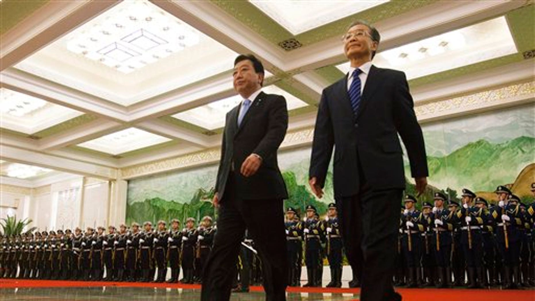 Dec. 25: Japanese Prime Minister Yoshihiko Noda, left, walks with Chinese Premier Wen Jiabao after attending a welcoming ceremony at the Great Hall of the People in Beijing.