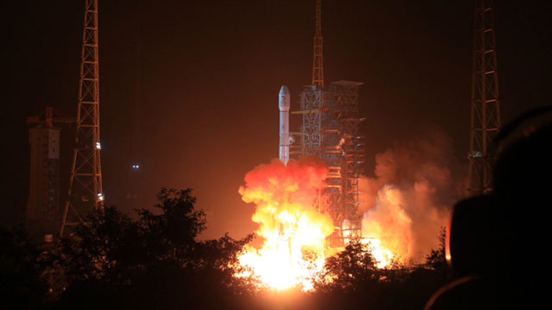 December 2, 2013: In this photo released by China's Xinhua News Agency, the Long March 3B rocket carrying the Chang'e-3 lunar probe blasts off from the launch pad at Xichang Satellite Launch Center, southwest China's Sichuan Province. (AP Photo/Xinhua, Li Gang)