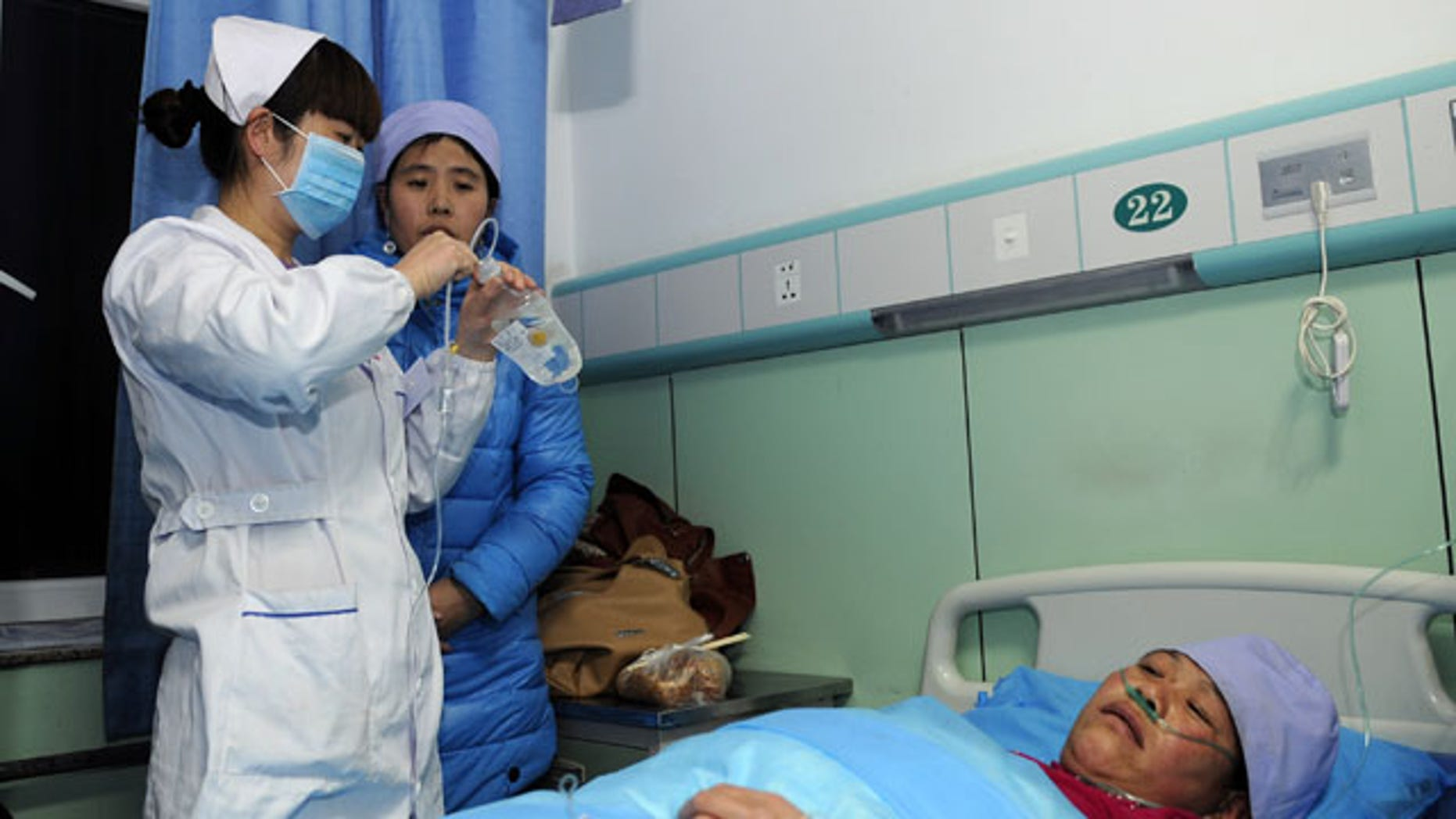 January 5, 2014: An injured woman receives medical treatment at a hospital in Xiji Town of Guyuan, northwest China's Ningxia region. China's Xinhua News Agency said Monday that 14 people were killed in a stampede at a mosque in the country's north and 10 other people were injured in the incident in Guyuan. (AP Photo/Xinhua, Li Ran)