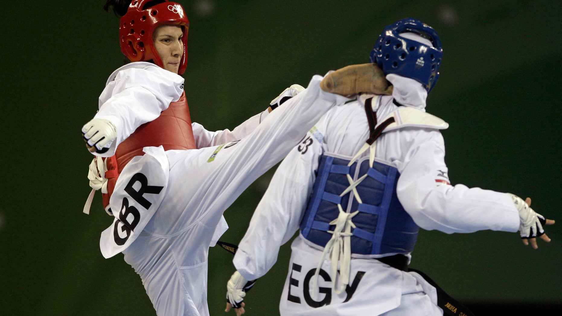 Aug. 23, 2008: Britain's Sarah Stevenson, left, fights with Egypt's Noha Abd Rabo in a bronze medal match for the women's taekwondo +67 kilogram class at the Beijing 2008 Olympics in Beijing.