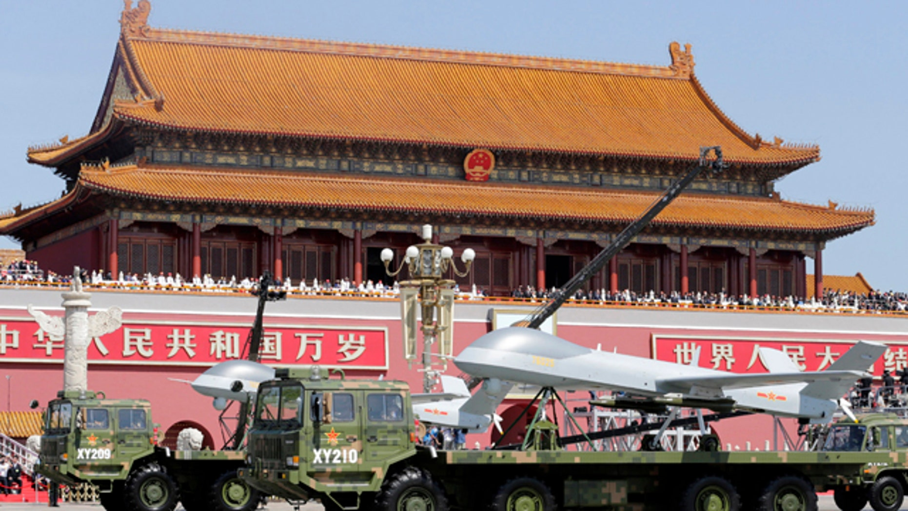 Sept. 3, 2015: Chinese military vehicles carry Pterodactyl I unmanned aerial vehicles past the Tiananmen Gate during a military parade to commemorate the 70th anniversary of the end of World War II in Beijing. (Jason Lee/Pool Photo via AP)