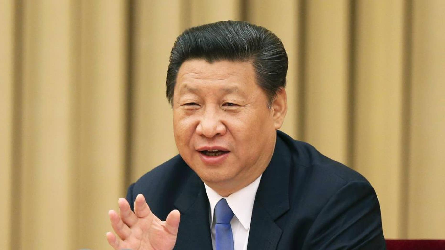 In this photo released by China's Xinhua News Agency,  Chinese President Xi Jinping addresses a high-level party meeting that sought to unite non-Communist Party groups and individuals in Beijing Wednesday, May 20, 2015. Xi warned that religions must be independent from foreign influence, as the government asks domestic religious groups to pledge loyalty to the state. China is ruled by the officially atheist Communist Party, and Beijing attempts to control a variety of religions and their spread. (Ma Zhancheng/XInhua via AP)  NO SALES