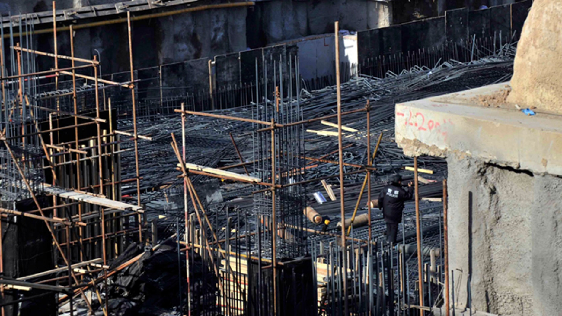 Dec. 29, 2014: This photo released by China's Xinhua News Agency shows the construction site where a scaffolding collapsed in the Tsinghua High School in Beijing. (AP Photo/Xinhua, Li Wen)