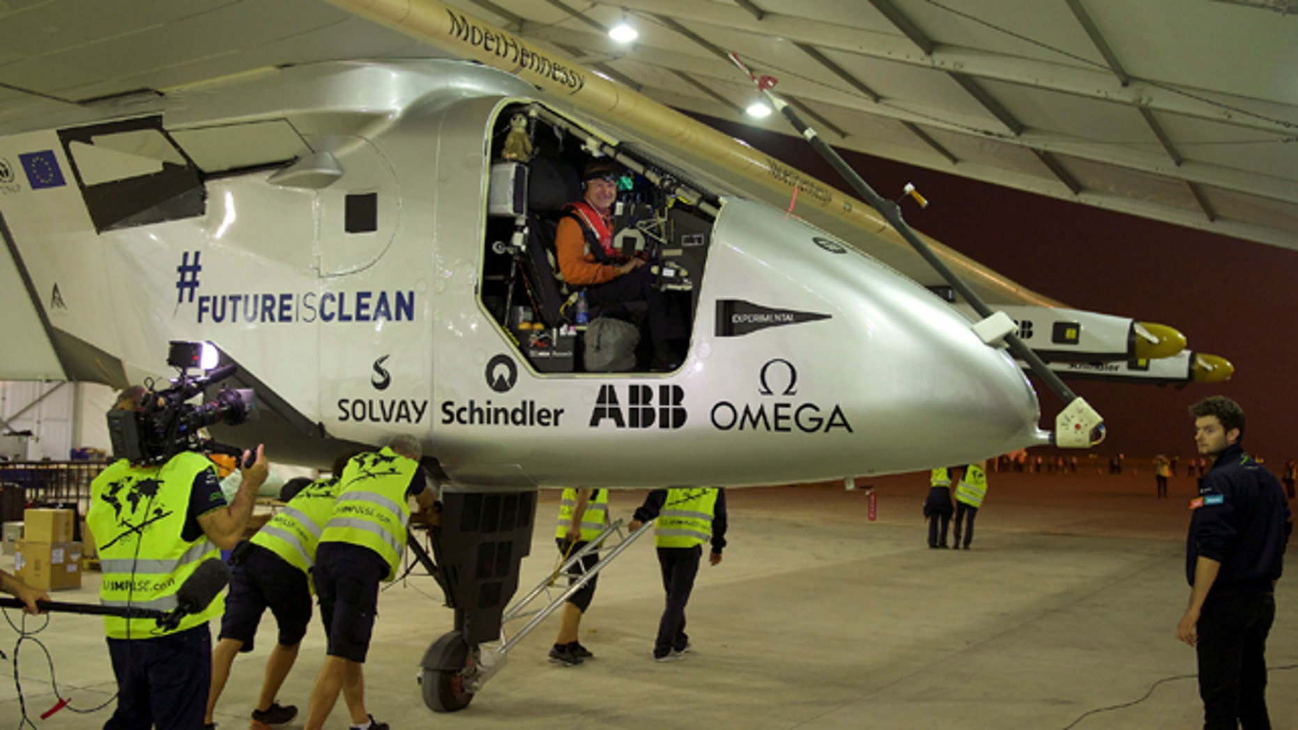 May 31, 2015: Crew members push the aircraft Solar Impulse 2 piloted by Swiss Andre Borschberg out of a hangar before taking off at Nanjing Lukou International Airport in Nanjing in eastern China's Jiangsu province. (Chinatopix via AP)