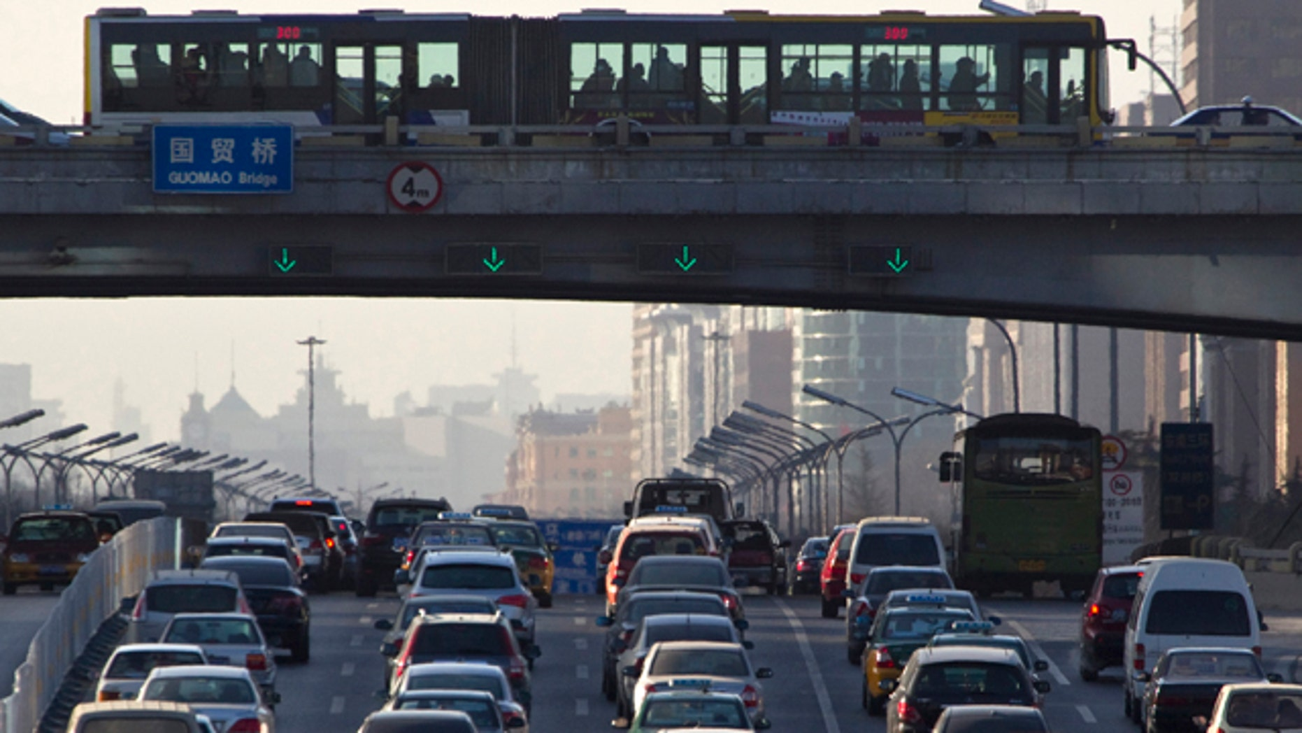 Dec. 23, 2010: Vehicles pack the main roads during the day in central Beijing, China.