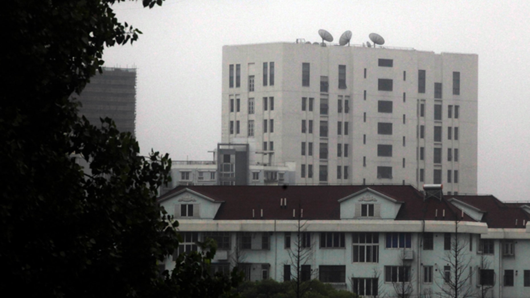 "May 31, 2013: This file photo shows the building housing Unit 61398 of the Peoples Liberation Army, center top, on the outskirts of Shanghai, China. A U.S. security firm, Mandiant, said last year it traced attacks on American and other companies to the military unit in Shanghai.  China on Tuesday, May 20, 2004, warned the United States was jeopardizing military ties by charging five Chinese officers with cyberspying and tried to turn the tables on Washington by calling it ""the biggest attacker of China's cyberspace.""  (AP)"