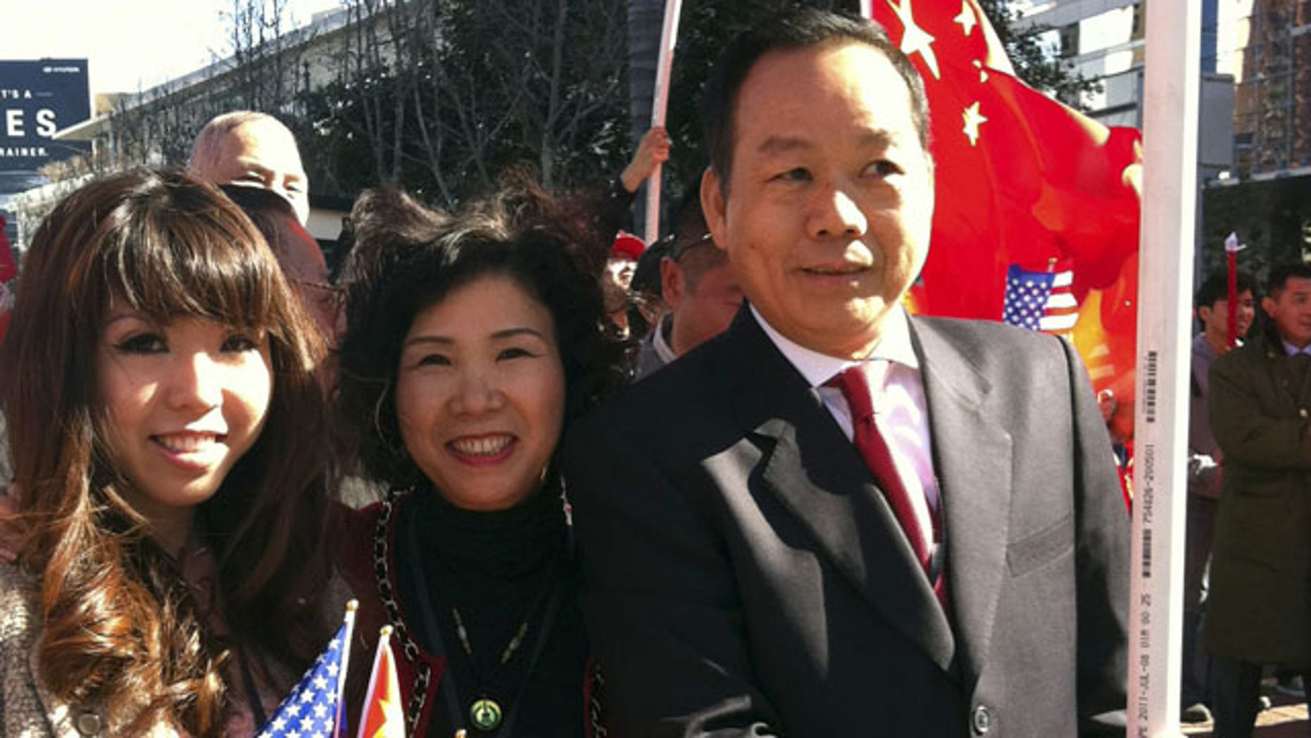 FILE - In this Feb. 16, 2012 file photo released by Anna Wu, American businessman Vincent Wu, right, poses for a photo with his wife Yip Lai Fong, center, and daughter Anna Wu as they wait to welcome China's then-Vice President Xi Jinping on his visit to Los Angeles, Calif. (AP)