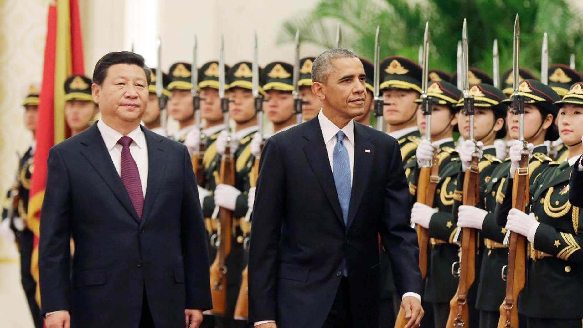 U.S. President Barack Obama, right, and Chinese President Xi Jinping review the honor guard during a welcome ceremony at the Great Hall of the People in Beijing, Wednesday, Nov. 12, 2014. When Xi Jinping took the reins of a booming China two years ago, President Barack Obama saw an opportunity to remake America's relationship with the Asian power. But even after Obama's unusually robust efforts to forge personal ties with Xi, the two leaders are meeting in Beijing amid significant tensions, both old and new. (AP Photo/Andy Wong)