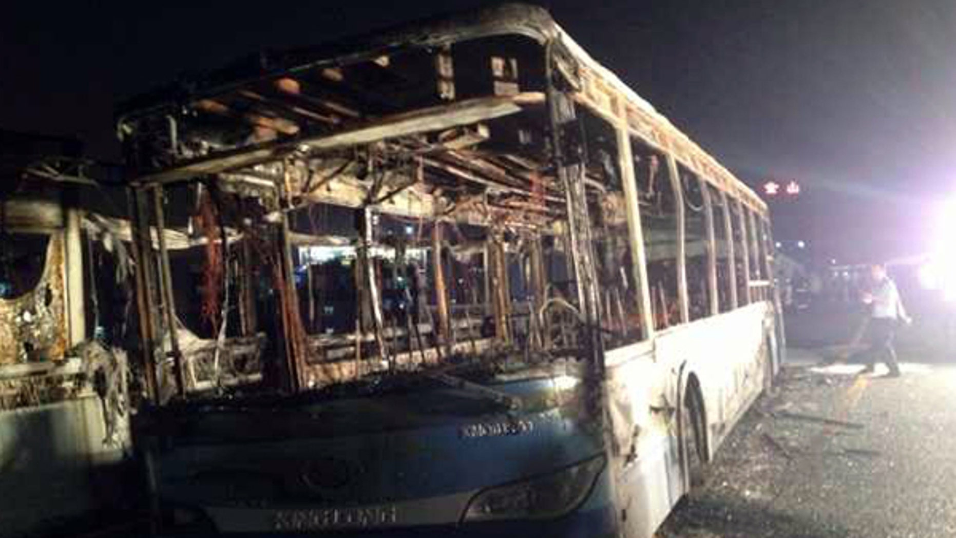 June 7, 2013: This image made with a mobile phone camera released by China's Xinhua News Agency shows the remains of an express bus that burst into flames in Xiamen, southeast China's Fujian Province. The express bus burst into flames on an elevated road in southeastern China on Friday, killing at least 30 people and injuring more than 30, state media reported.