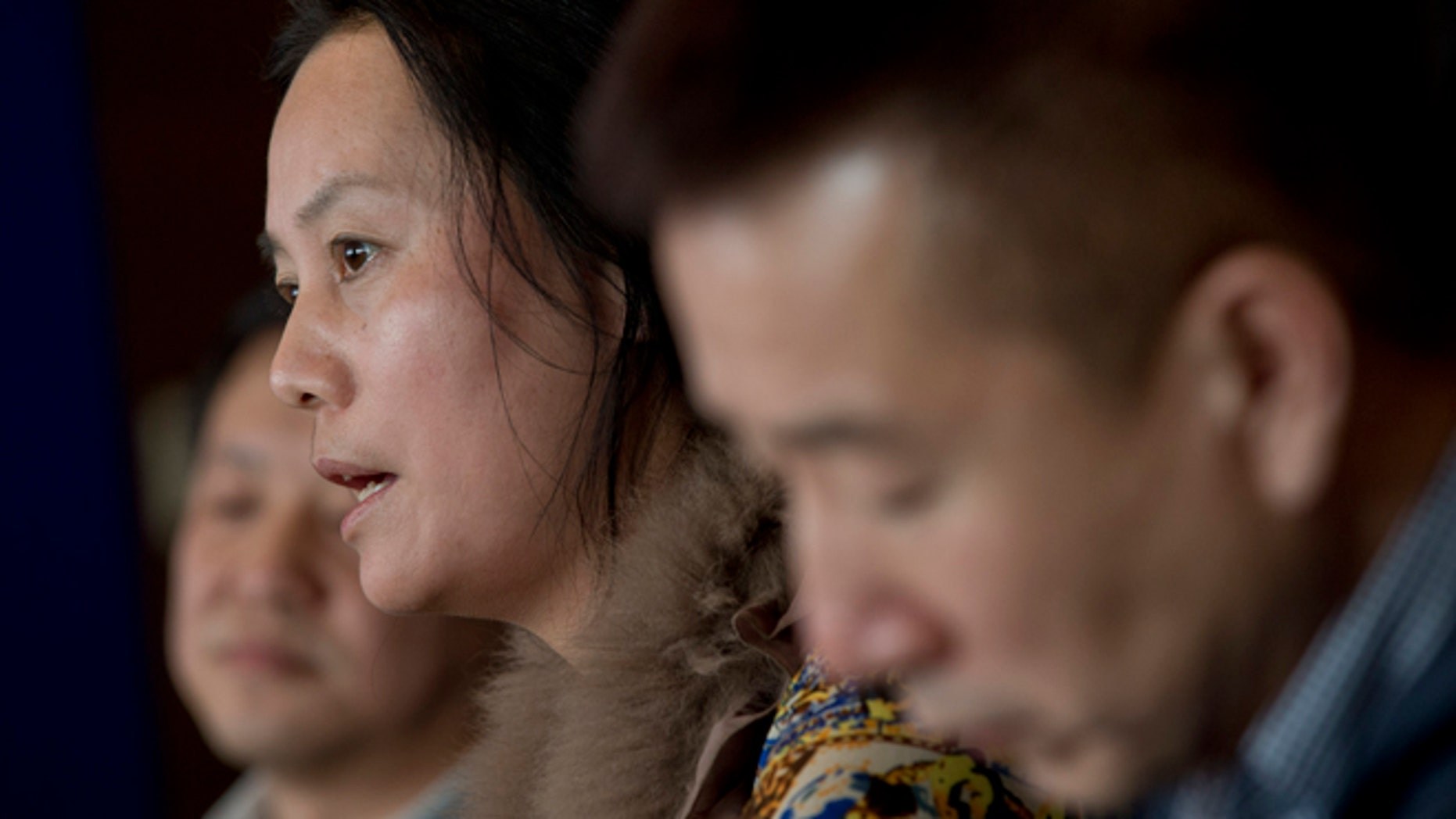 March 4, 2014: Chinese Investor applicant Duan Wuhong, center, speaks next to Rong Bing, left, and Du Jun, right, during a press conference of Immigrant Investors to Canada Unite and Demand Justice! held in Beijing, China.