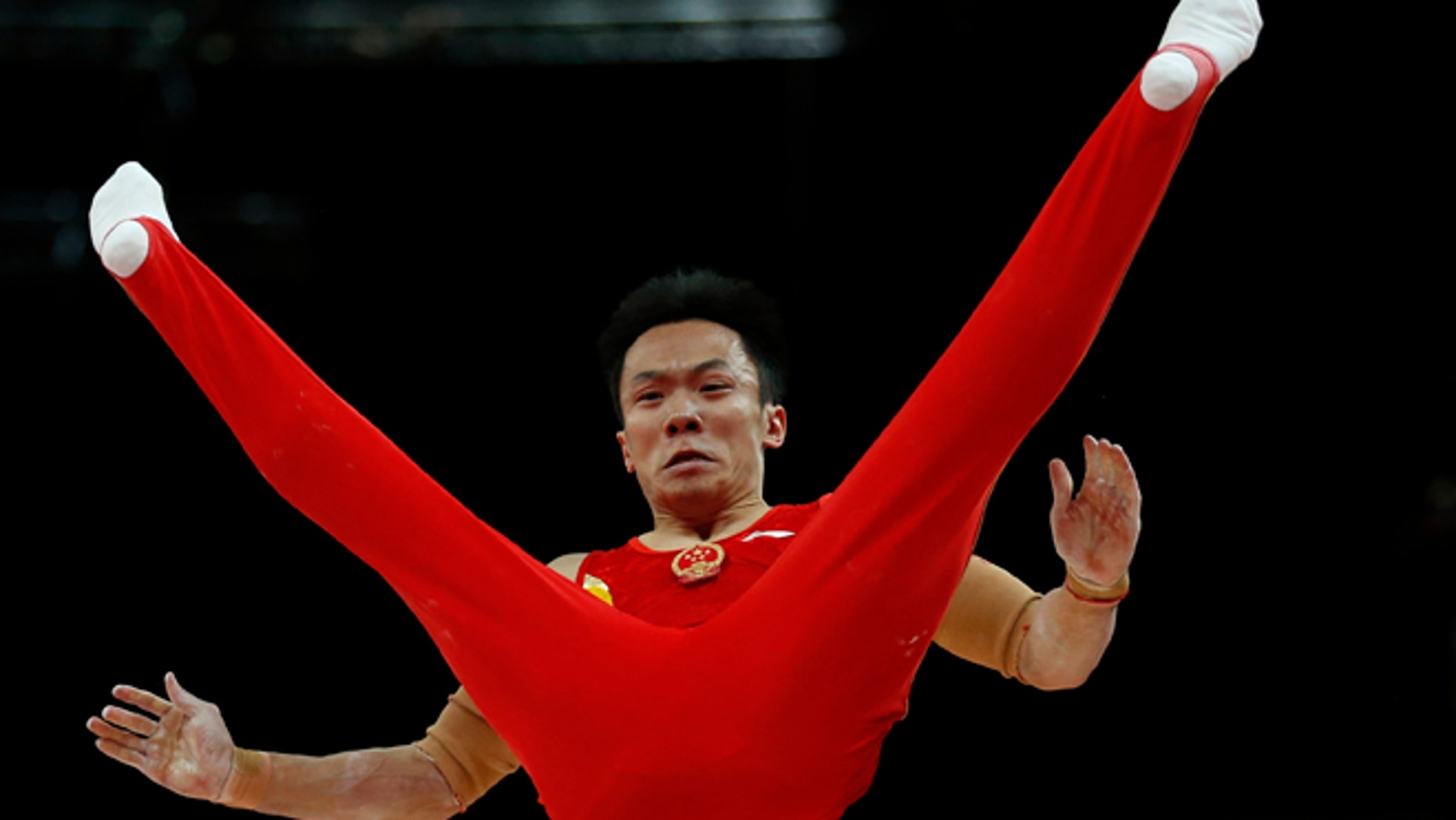 July 30, 2012: Chinese gymnast Guo Weiyang performs on the parallel bars during the Artistic Gymnastic men's team final at the 2012 Summer Olympics,  in London.