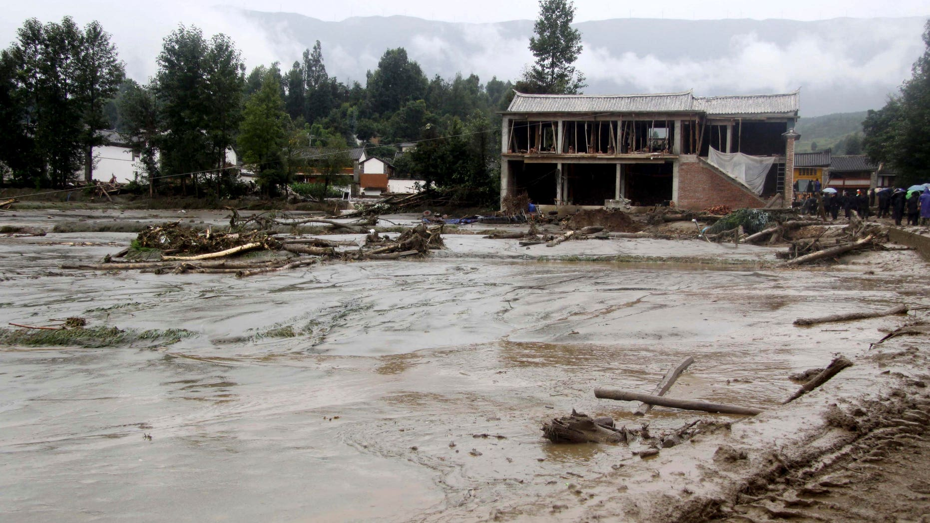 Aug. 6, 2012: In this photo released by China's Xinhua News Agency, mud covers the area after a mudslide in Tiejia Village of Eryuan County of Dali Bai Autonomous Prefecture, southwest China's Yunnan Province.