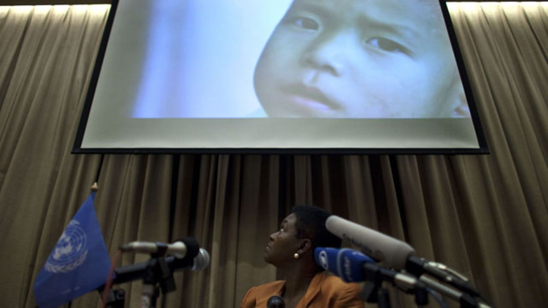 Oct. 21, 2011: Valerie Amos, U.N. undersecretary-general for Humanitarian Affairs and Emergency Relief Coordinator, looks at an image showing a North Korean child during a press conference in Beijing, China.