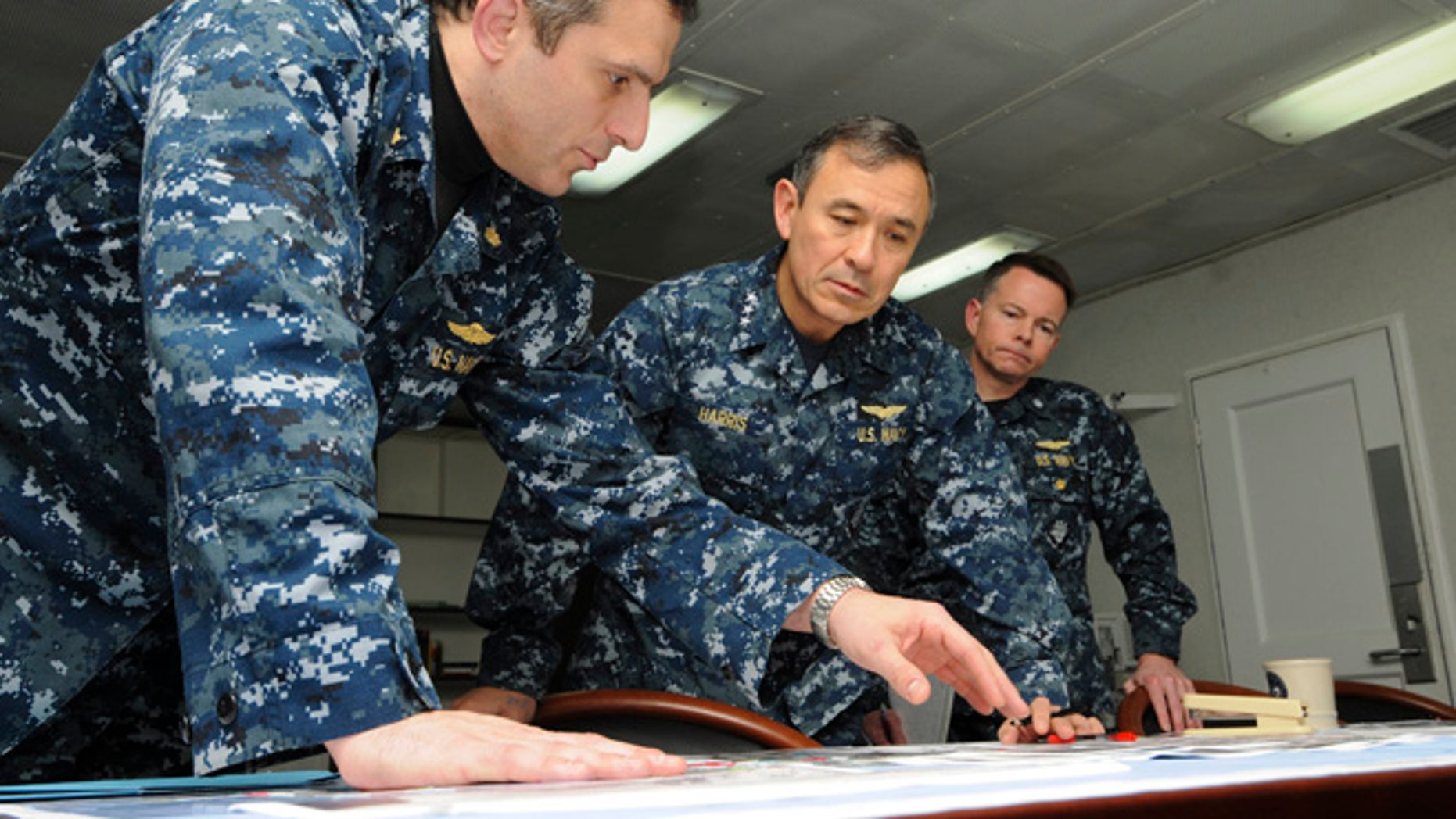 FILE 2011: Defense Secretary Voltaire Gazmin said the commander, Adm. Harry Harris Jr., center, assured him of U.S. readiness to provide assistance.