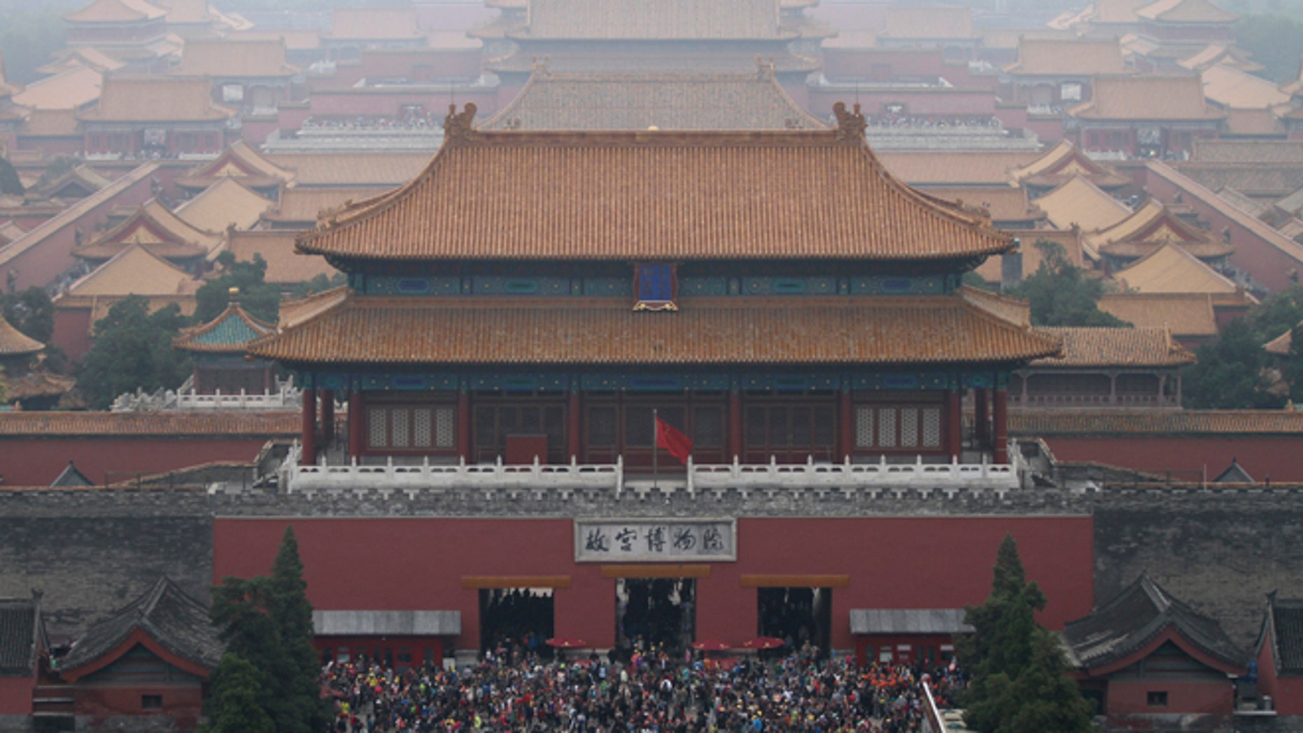 This Oct. 3, 2014 file photo shows tourists at the Forbidden City in Beijing, China.