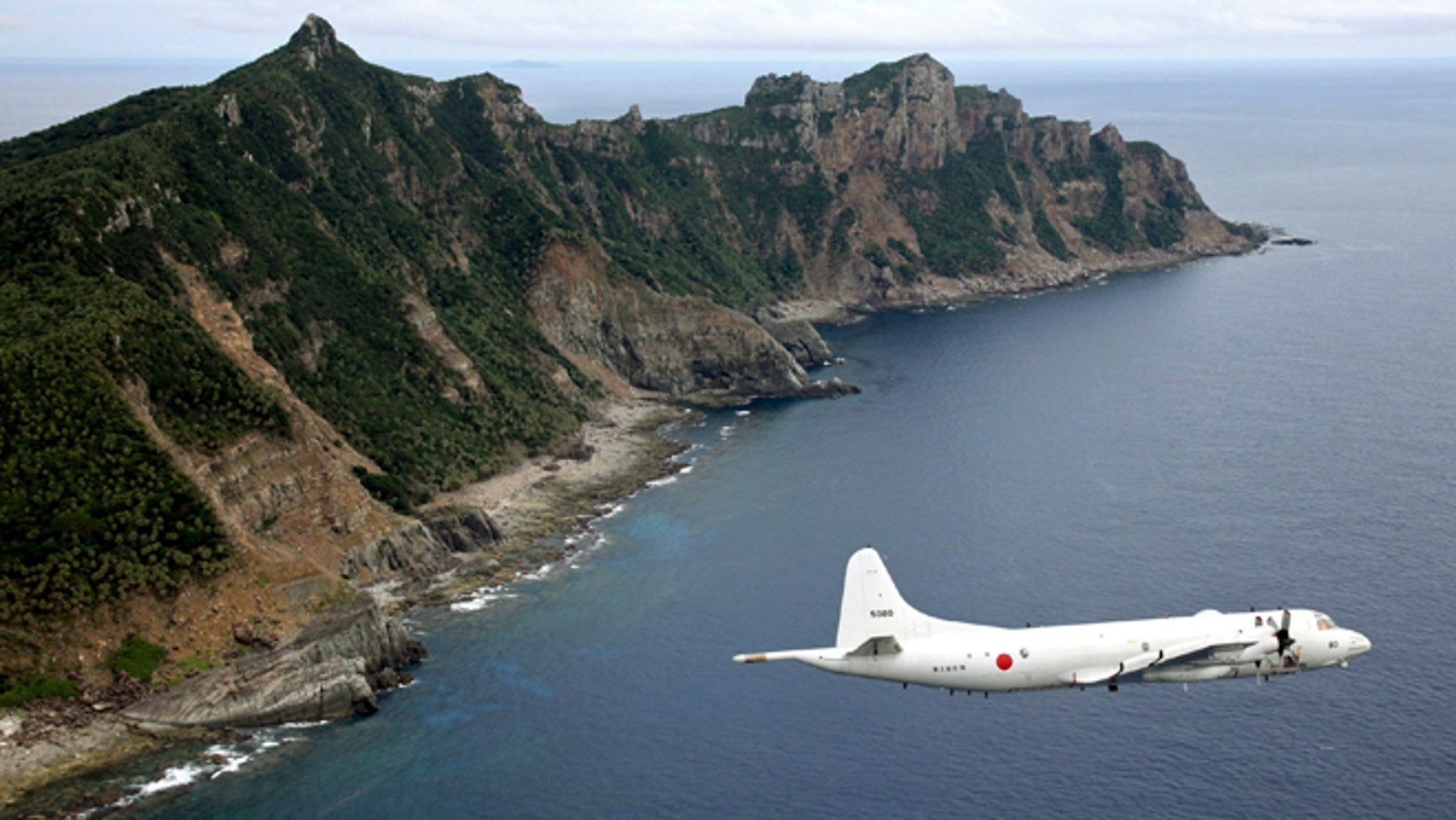 FILE Oct. 2011: Japan Maritime Self-Defense Force's P-3C Orion surveillance plane flies over the disputed islands in the East China Sea, called the Senkaku in Japan and Diaoyu in China.