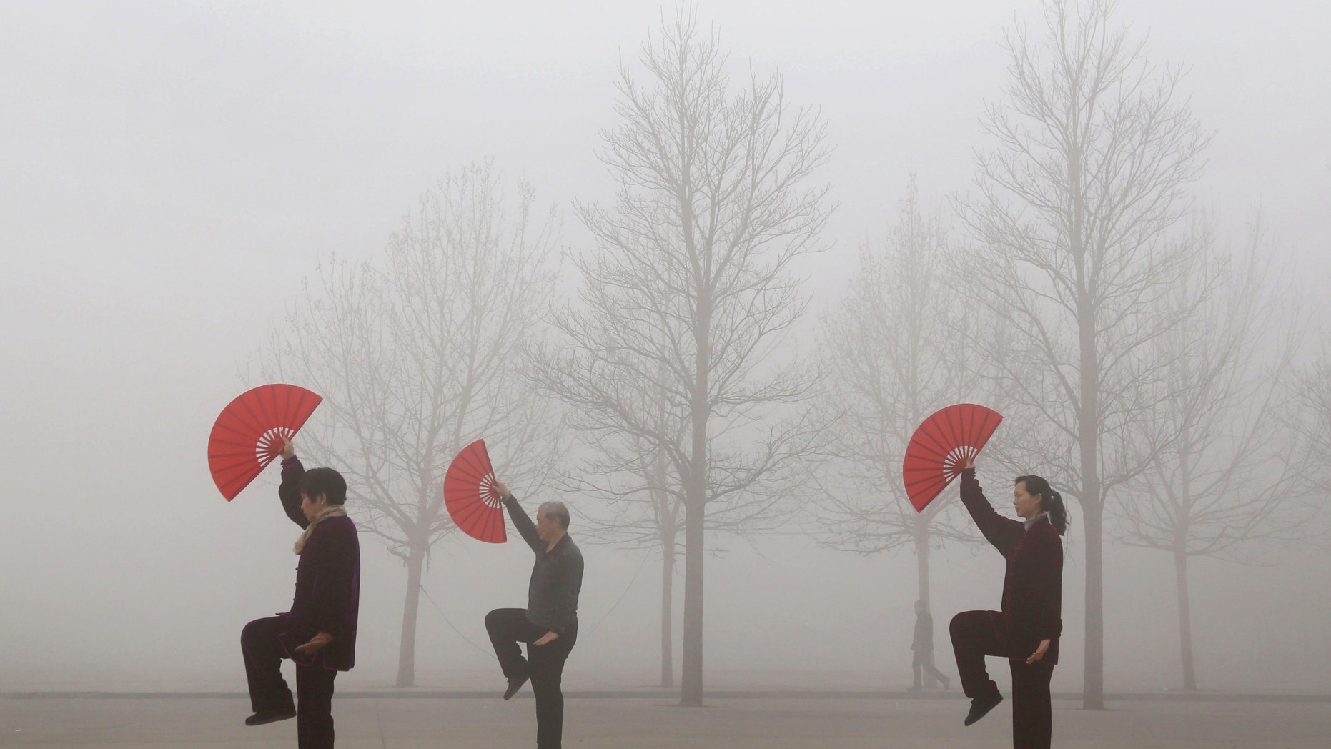 March 16, 2015: People do morning exercises on a polluted day in Jiaozuo, Henan province.