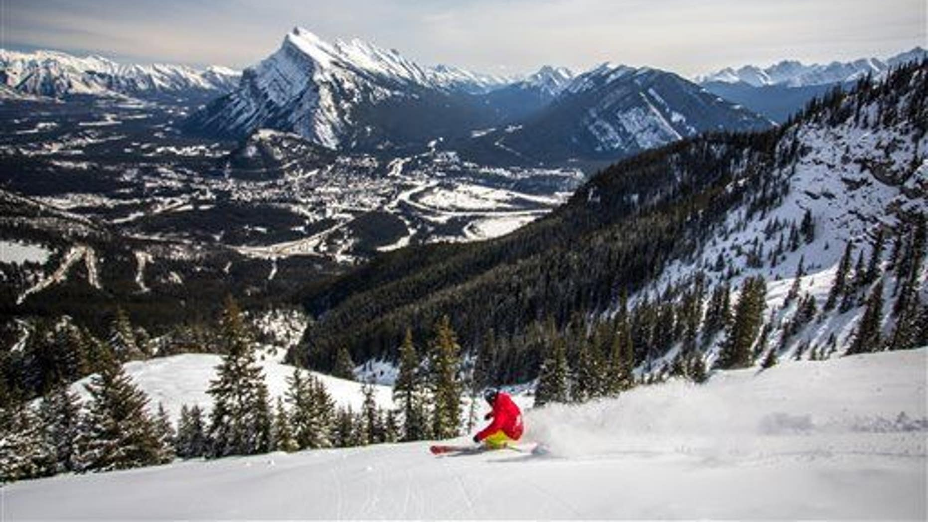A snowboarder on the mountain in the Canadian Rockies, just 15 minutes from Banff, Alberta.