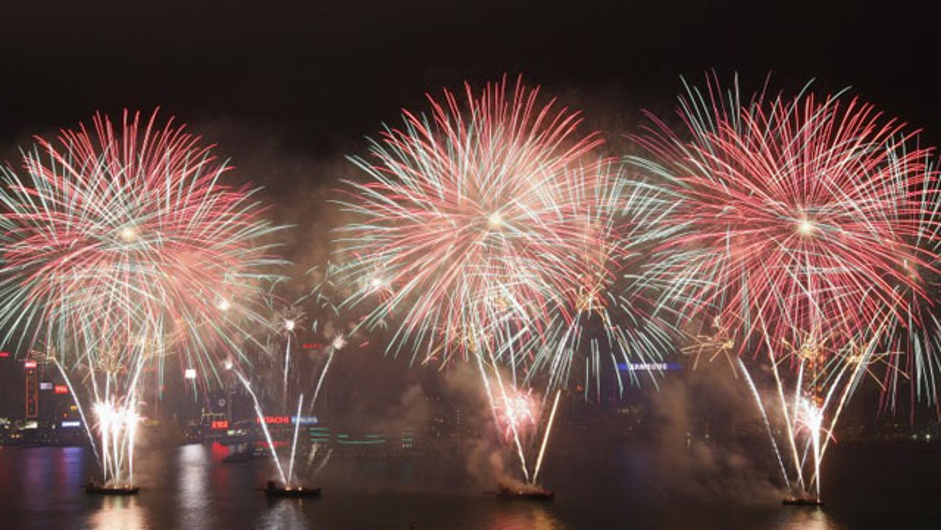 January 24, 2012: Fireworks light up the sky over the Victoria Harbor to celebrate the Chinese Lunar New Year in Hong Kong (Reuters)