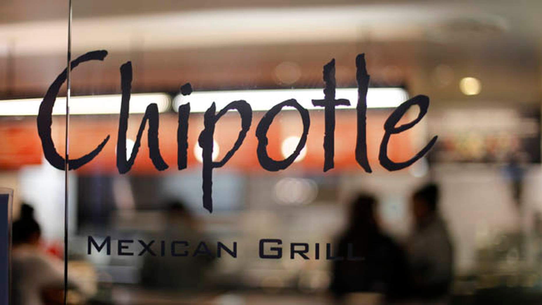 This Sunday, Dec. 27, 2015, photo, shows a Chipotle restaurant at Union Station in Washington. Chipotle said Wednesday, Jan. 6, 2016, it has been served with a federal grand jury subpoena as part of a criminal investigation tied to a norovirus outbreak this summer at one of its restaurants in California. (AP Photo/Gene J. Puskar)