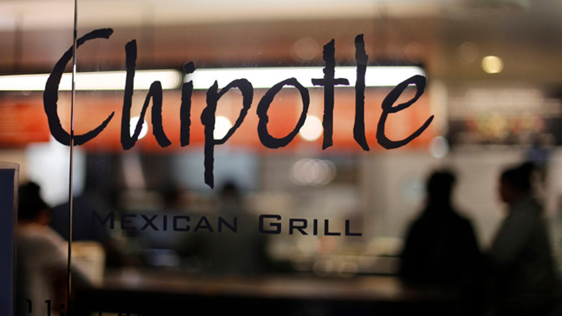 FILE - This Sunday, Dec. 27, 2015, file photo, shows a Chipotle restaurant in Union Station in Washington. (AP Photo/Gene J. Puskar, File)