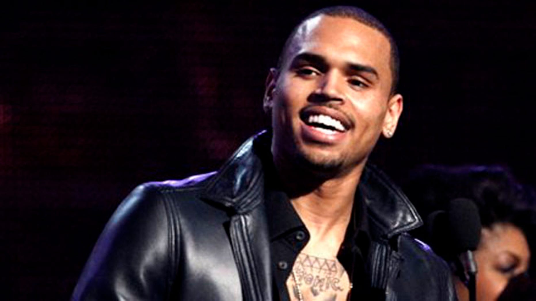 "Feb. 12, 2012: In this file photo, Chris Brown accepts the award for best R&B album for ""F.A.M.E."" during the 54th annual Grammy Awards in Los Angeles."