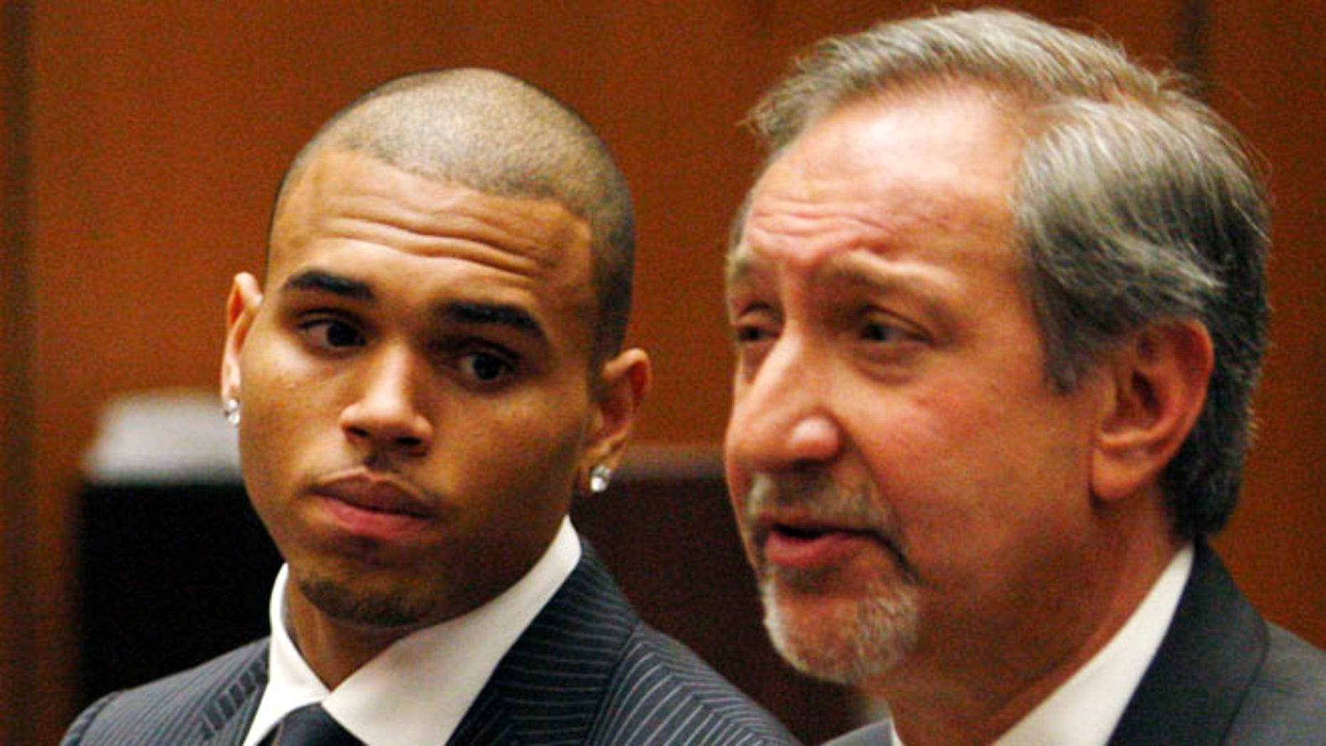 Aug. 25, 2009: In this file photo, Chris Brown looks on alongside his attorney Mark Geragos during his sentencing for assaulting his girlfriend Rihanna, at Los Angeles County Superior Court in Los Angeles.