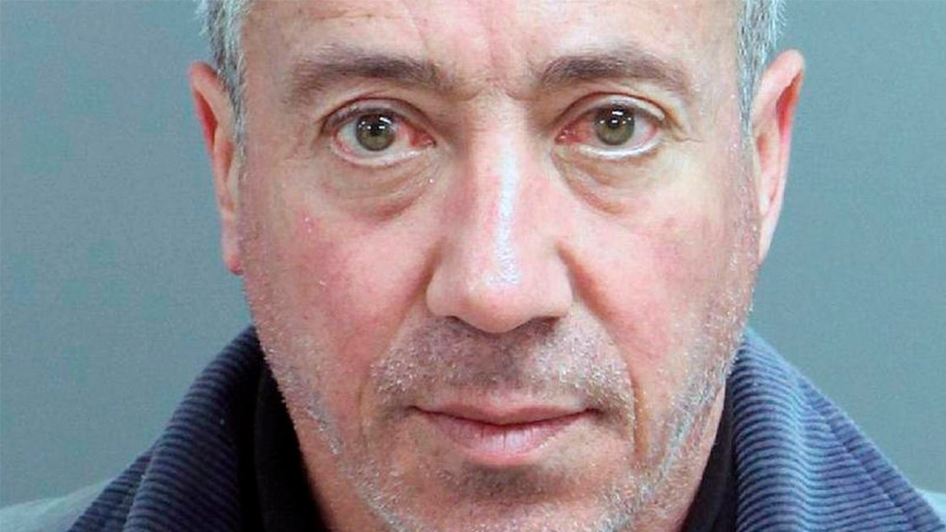This undated mug shot shows Christian Desgroux, 57, who's accused of pretending to be a U.S. Army general when he landed a chartered helicopter at a technology company in North Carolina in November.