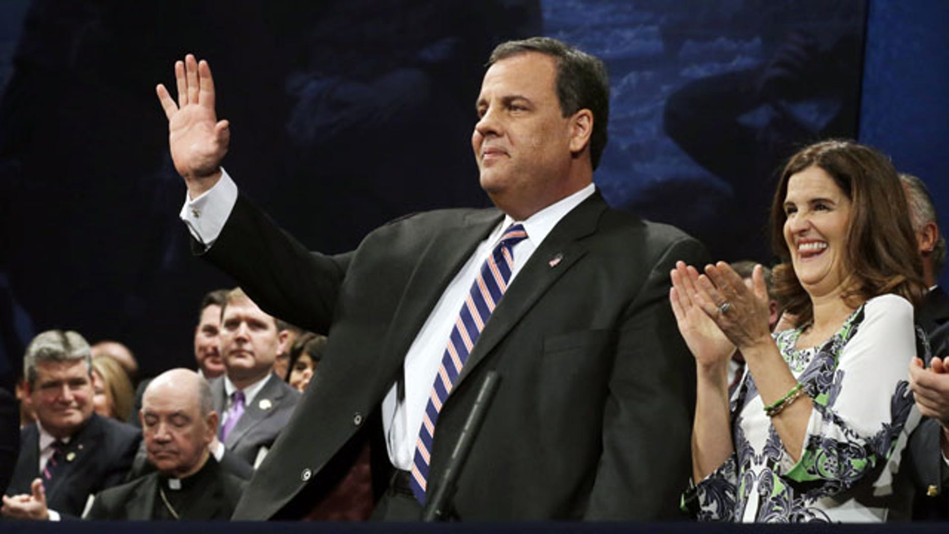 January 21, 2014: New Jersey Gov. Chris Christie waves as he stands with his wife Mary Pat Christie during a gathering for his swearing in for his second term in Trenton, N.J. (AP Photo)