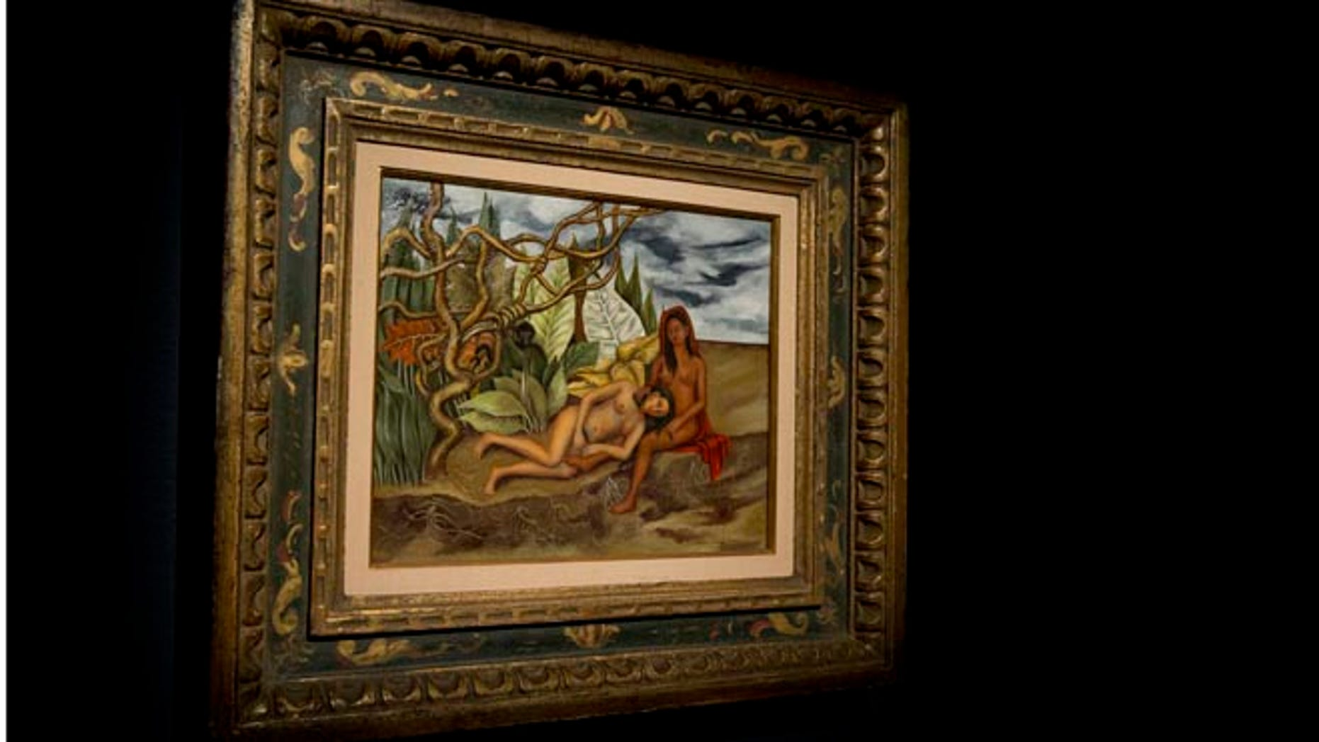 """EDS NOTE: NUDITY - In this Friday, April 29, 2016 file photo, the painting, """"Two Nudes in the Forest (The Land Itself)"""" by Frida Khalo, is on display during the press preview of """"Bound to Fail"""" at Christie's auction house in New York. The painting by Kahlo is poised to set a new auction record for the Mexican painter at Christieâs sale of impressionist and modern art on Thursday evening, May 12, 2016. (AP Photo/Mary Altaffer, File)"""